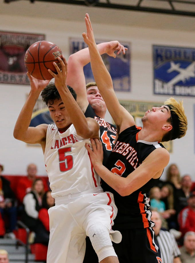 Manitowoc Lutheran's Santana Lomibao comes down with a rebound against Reedsville at Manitowoc Lutheran High School Thursday, December 20, 2018, in Manitowoc, Wis. Joshua Clark/USA TODAY NETWORK-Wisconsin