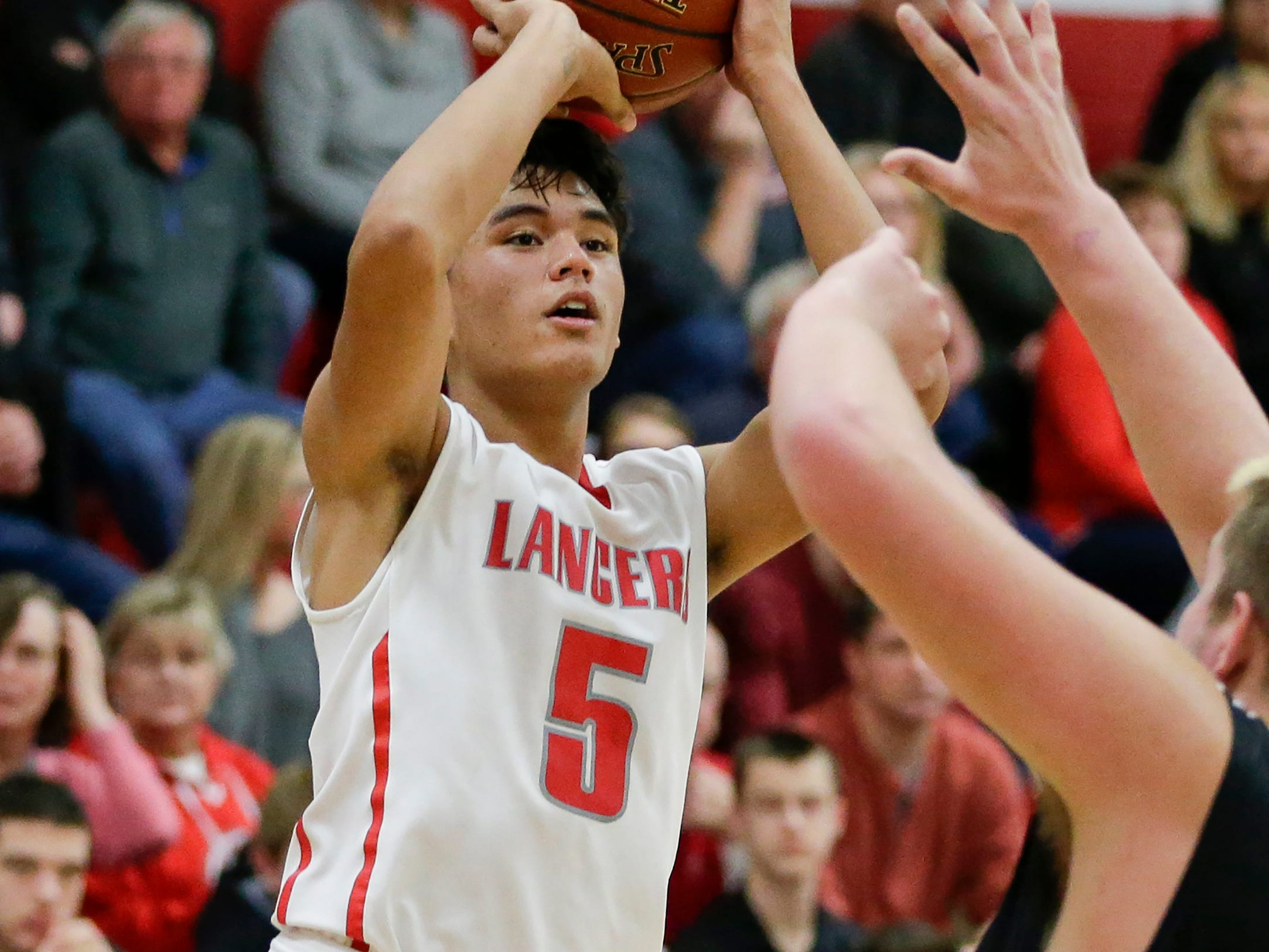 Manitowoc Lutheran's Santana Lomibao shoots against Reedsville at Manitowoc Lutheran High School Thursday, December 20, 2018, in Manitowoc, Wis. Joshua Clark/USA TODAY NETWORK-Wisconsin