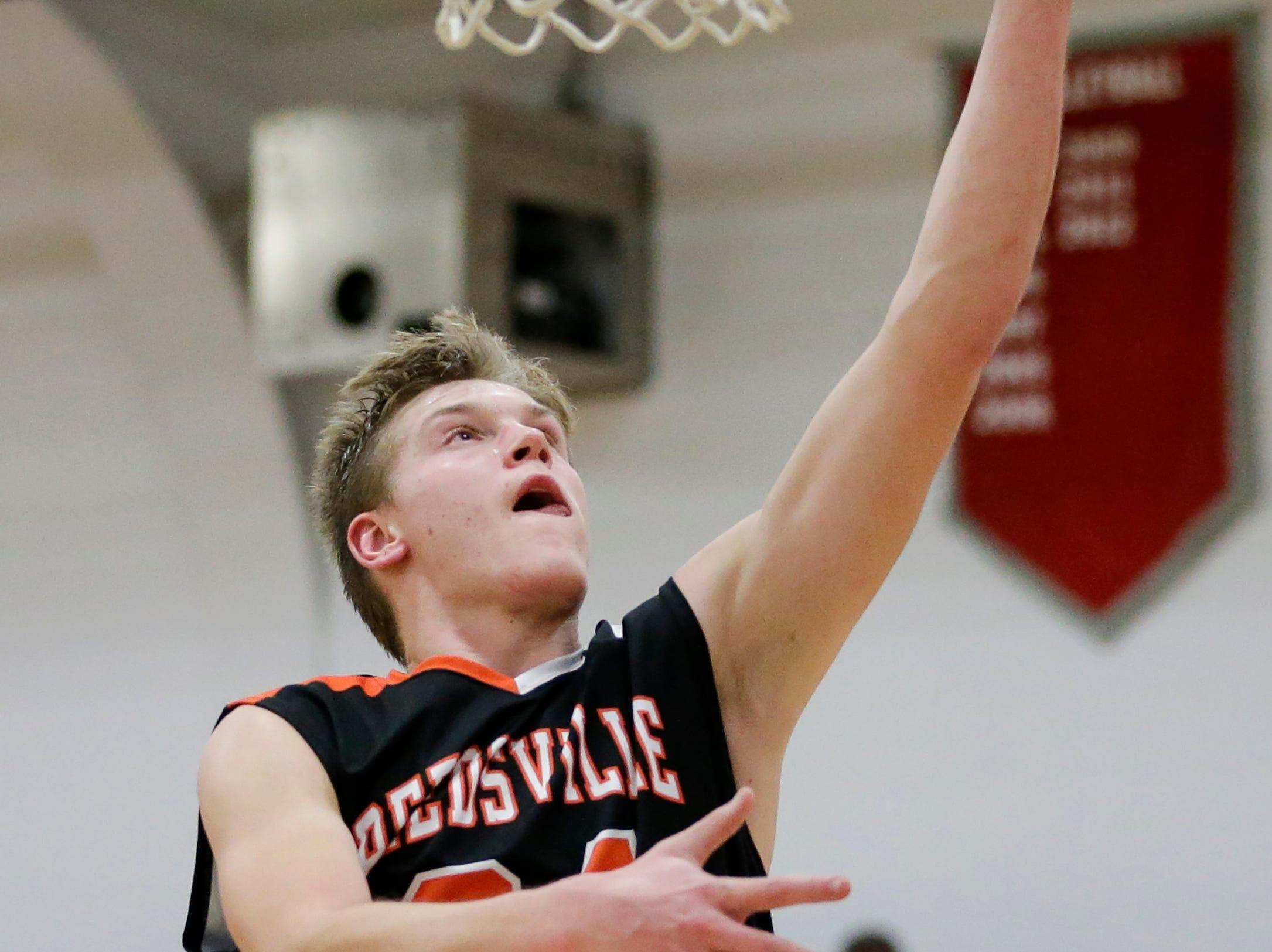Reedsville's Braiden Dvorachek scores with a layup against Manitowoc Lutheran at Manitowoc Lutheran High School Thursday, December 20, 2018, in Manitowoc, Wis. Joshua Clark/USA TODAY NETWORK-Wisconsin