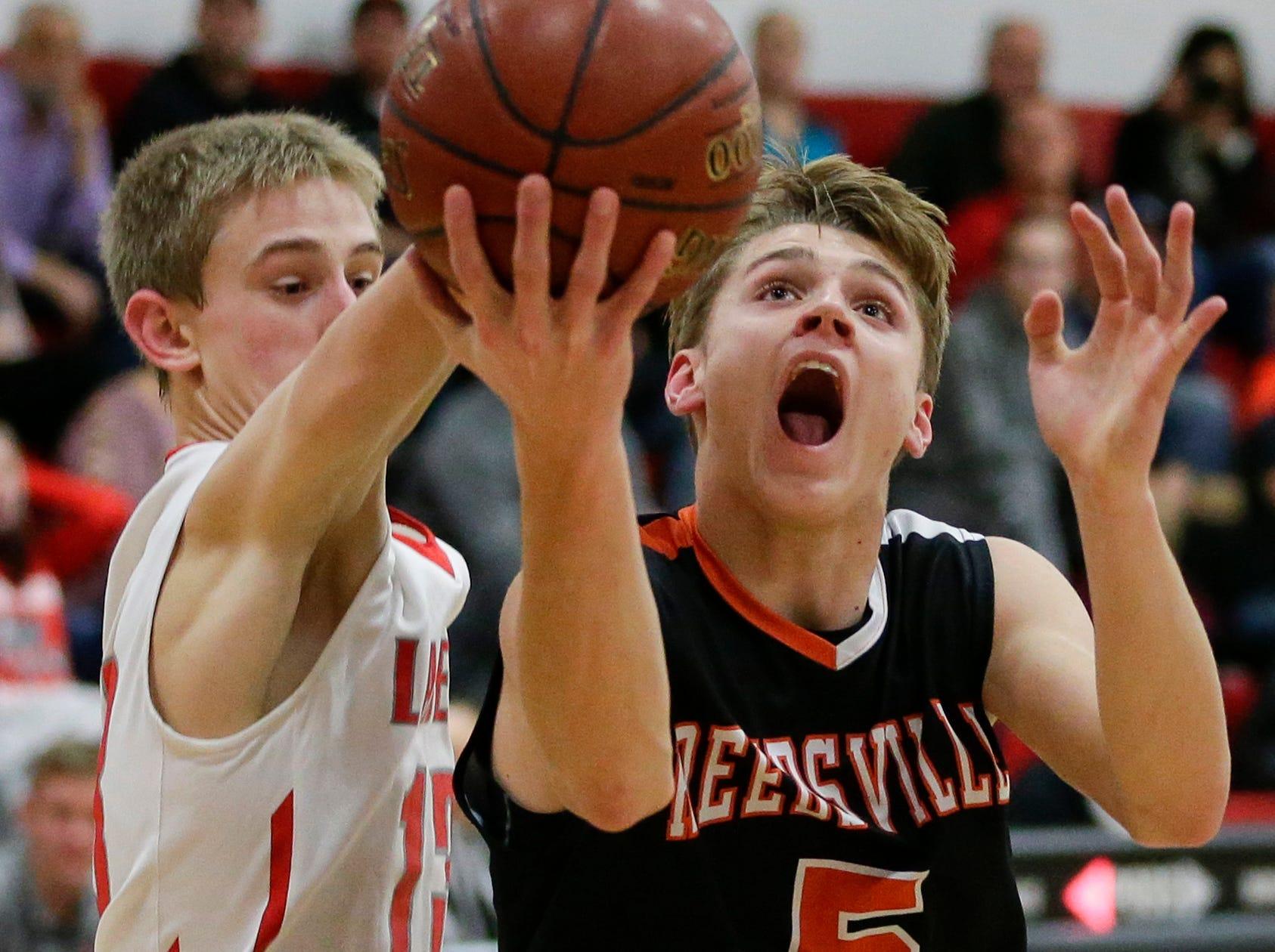 Reedsville's Brennen Dvorachek drives to the basket past Manitowoc Lutheran's Evan Lischka at Manitowoc Lutheran High School Thursday, December 20, 2018, in Manitowoc, Wis. Joshua Clark/USA TODAY NETWORK-Wisconsin