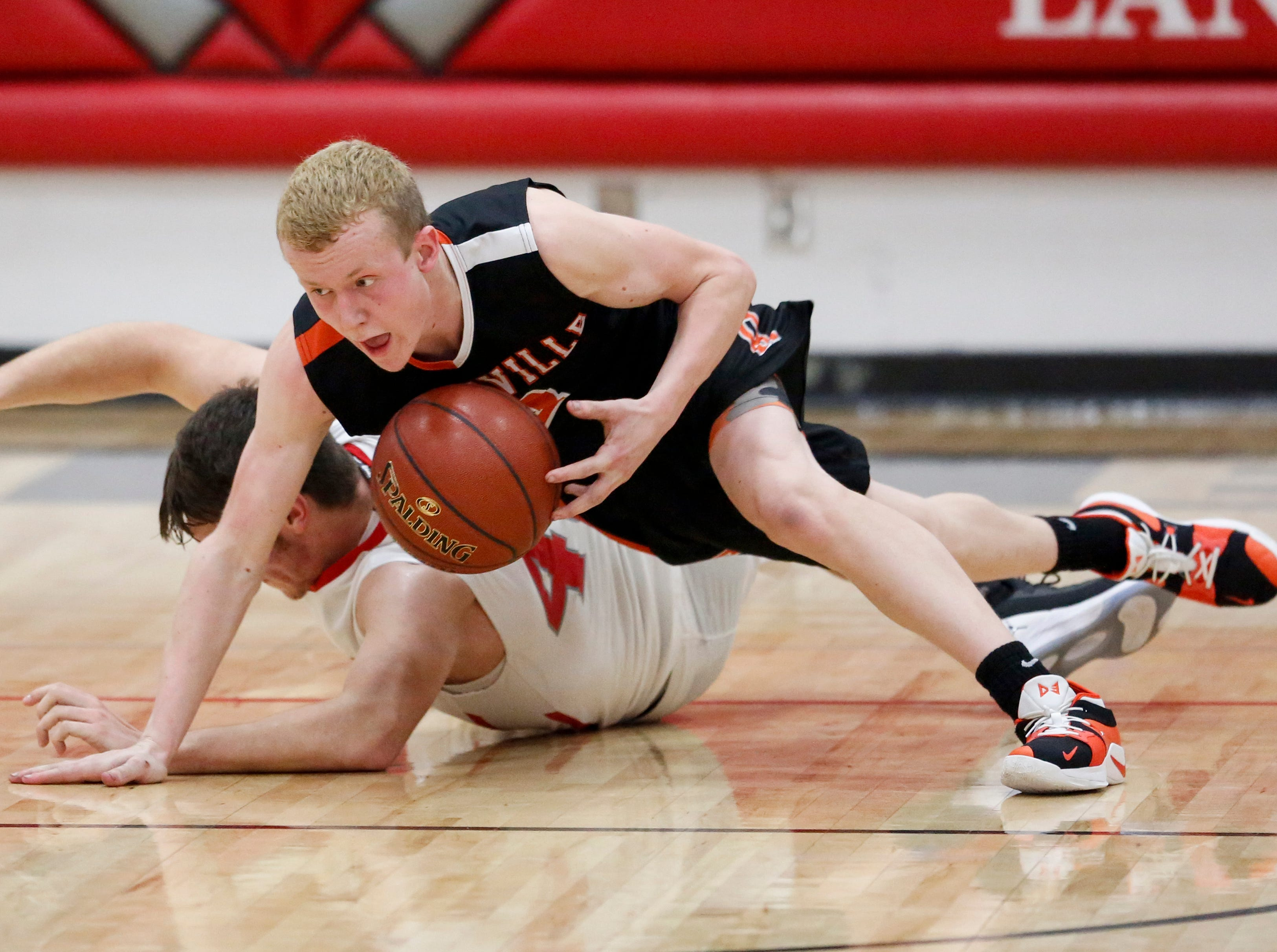 Reedsville's Brody Kiekhaefer steals a loose ball from Manitowoc Lutheran's Korey Garceau at Manitowoc Lutheran High School Thursday, December 20, 2018, in Manitowoc, Wis. Joshua Clark/USA TODAY NETWORK-Wisconsin