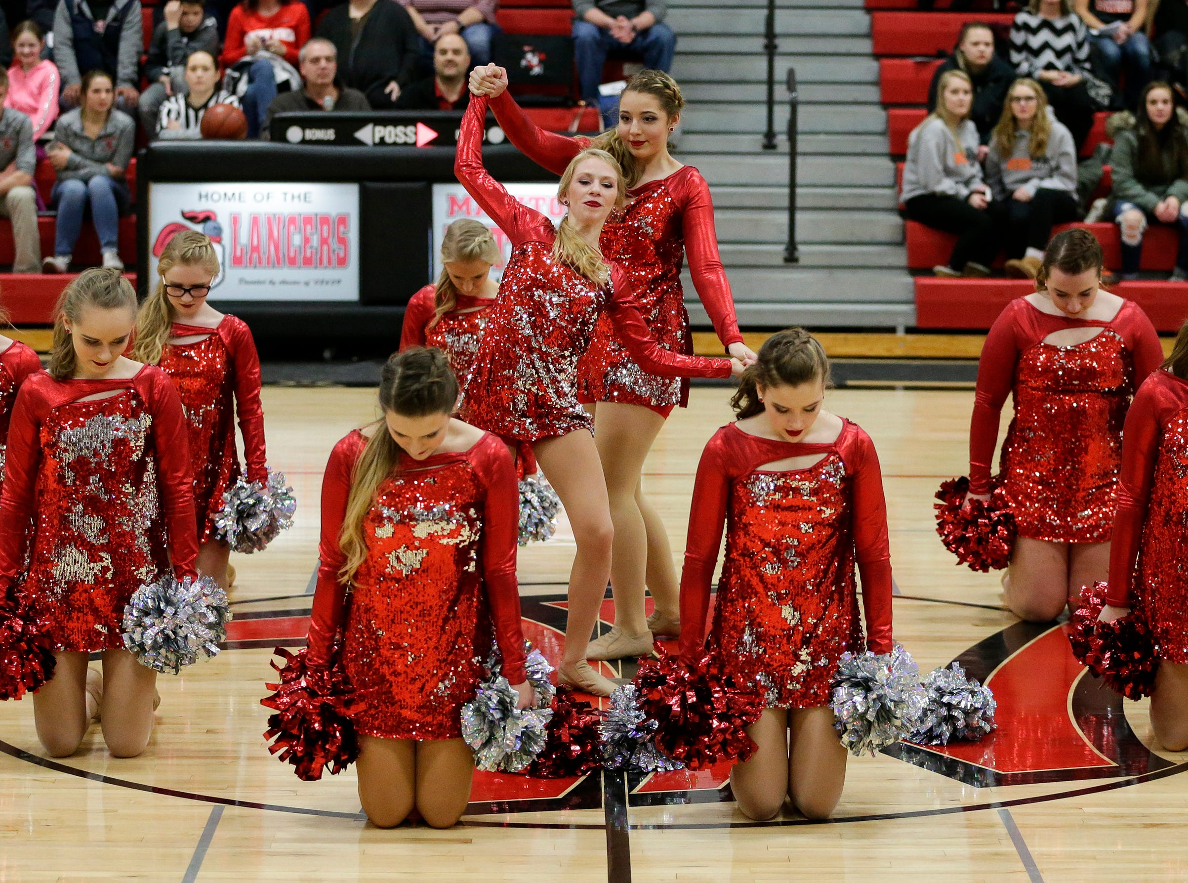 Manitowoc Lutheran's dance team performs at halftime during a matchup against Reedsville at Manitowoc Lutheran High School Thursday, December 20, 2018, in Manitowoc, Wis. Joshua Clark/USA TODAY NETWORK-Wisconsin