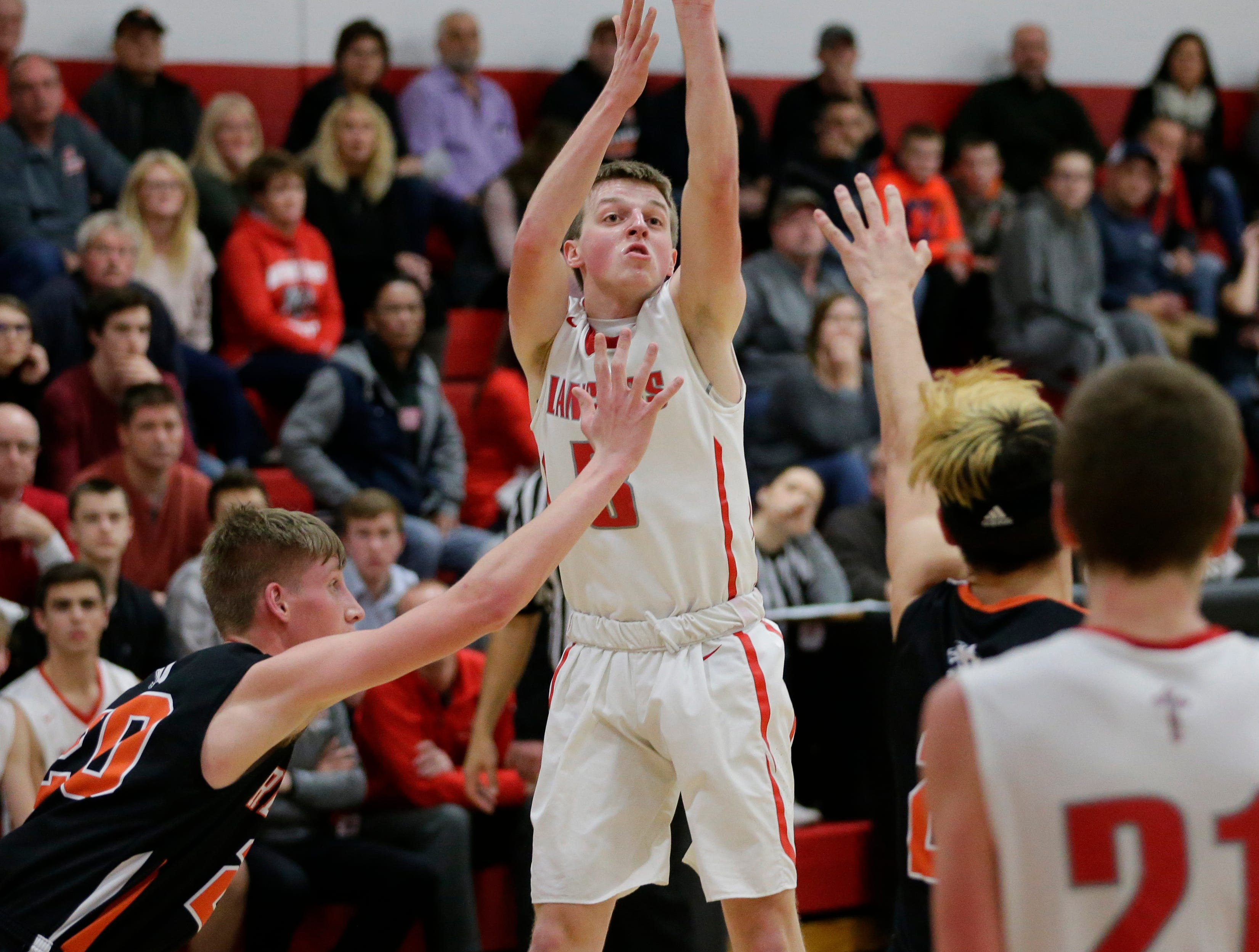 Manitowoc Lutheran's Trey Zastrow shoots against Reedsville at Manitowoc Lutheran High School Thursday, December 20, 2018, in Manitowoc, Wis. Joshua Clark/USA TODAY NETWORK-Wisconsin