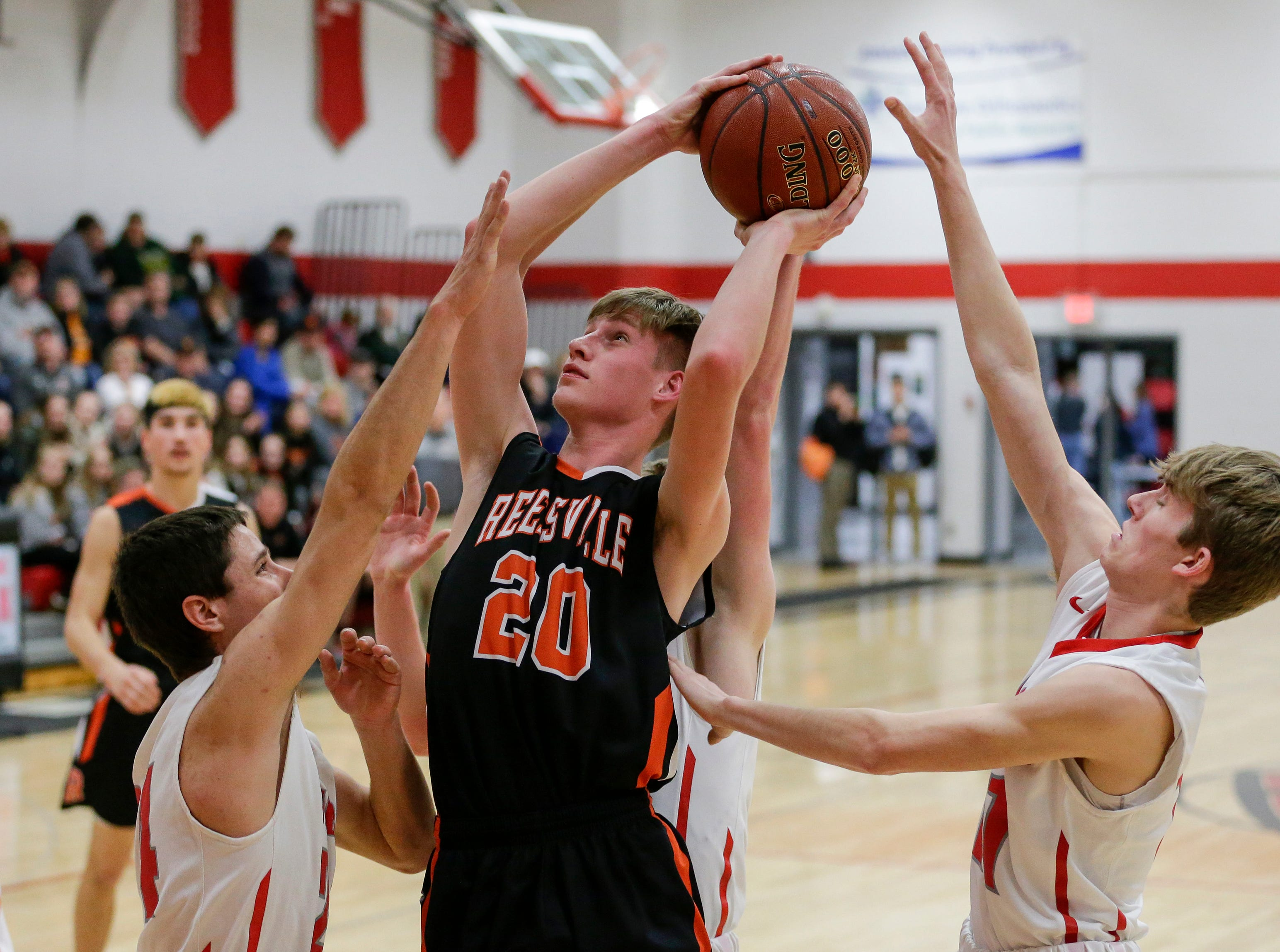 Reedsville's Cade Hafkey goes up for a shot against Manitowoc Lutheran at Manitowoc Lutheran High School Thursday, December 20, 2018, in Manitowoc, Wis. Joshua Clark/USA TODAY NETWORK-Wisconsin