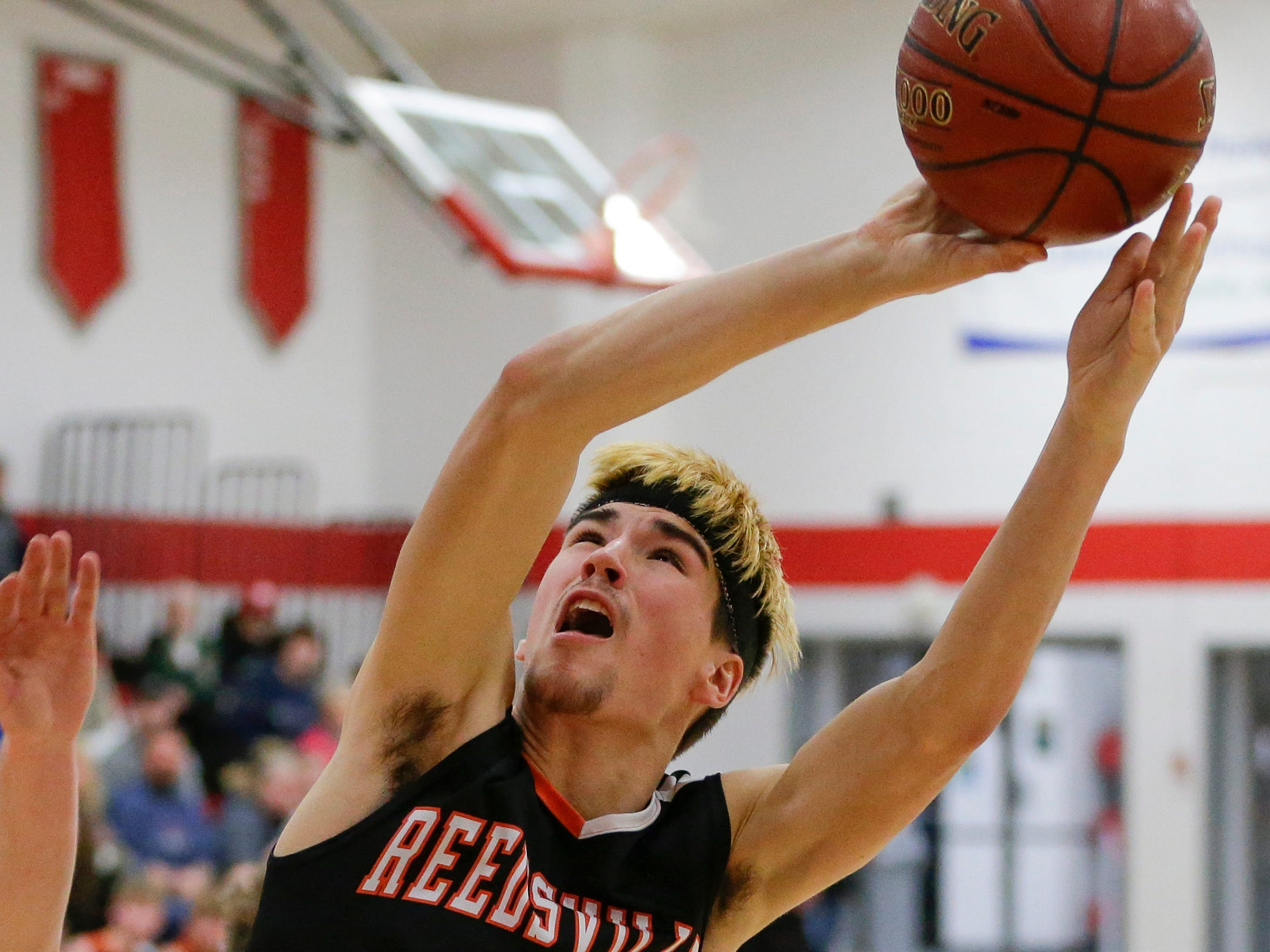 Reedsville's Noah Roffers shoots against Manitowoc Lutheran at Manitowoc Lutheran High School Thursday, December 20, 2018, in Manitowoc, Wis. Joshua Clark/USA TODAY NETWORK-Wisconsin