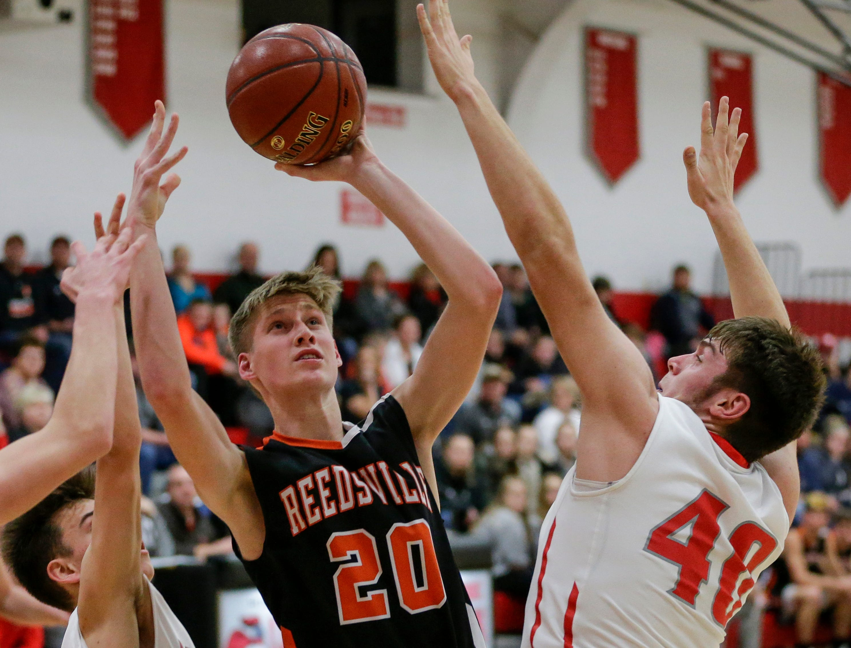 Reedsville's Cade Hafkey shoots against Manitowoc Lutheran at Manitowoc Lutheran High School Thursday, December 20, 2018, in Manitowoc, Wis. Joshua Clark/USA TODAY NETWORK-Wisconsin