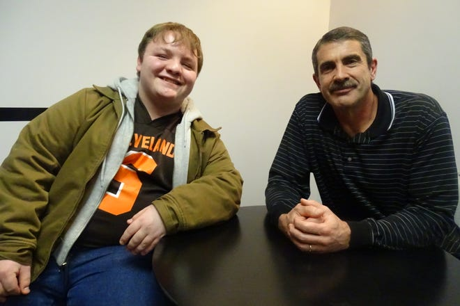 Brandon Himmelhaver, left, and Tim Harless are all smiles inside the office of Richland County Children's Services.