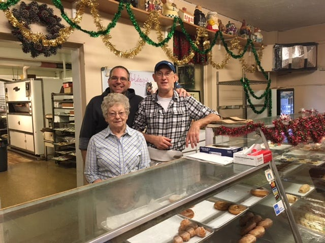 Buckeye Bakers and Schneider's Too is closing Saturday. Owner George Guegold, at right, and longtime employees Pauline Marcum and Ty Young said it is hard to say good-bye to customers. The bakery on Orange Street closes for good at noon Saturday.