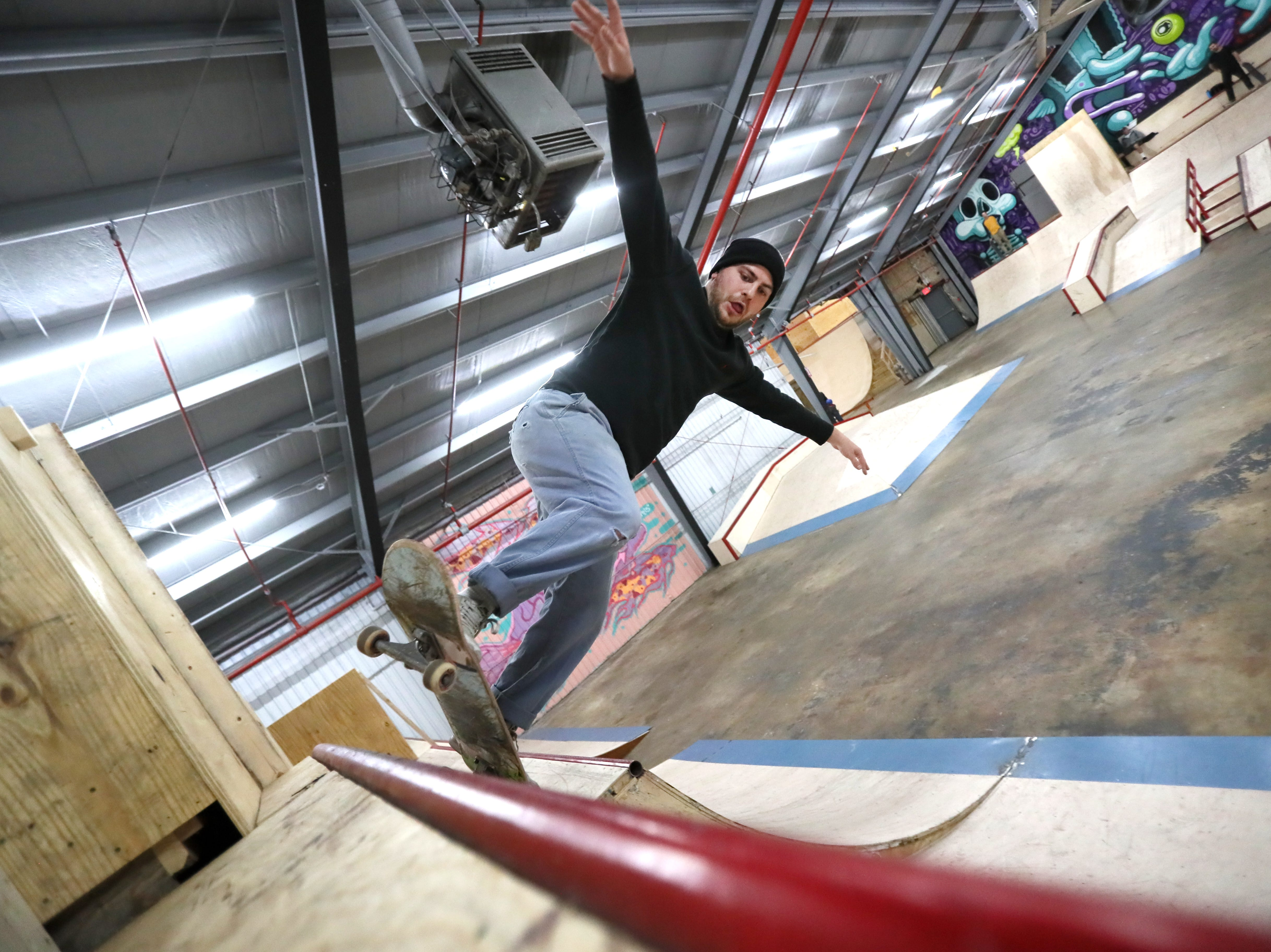 Nathan Woloshin, 26, rides inside Society Skatepark, a joint venture with Contact Skateboard Shop in the Broad Avenue Arts District which held its soft opening on Thursday, Dec. 20, 2018.