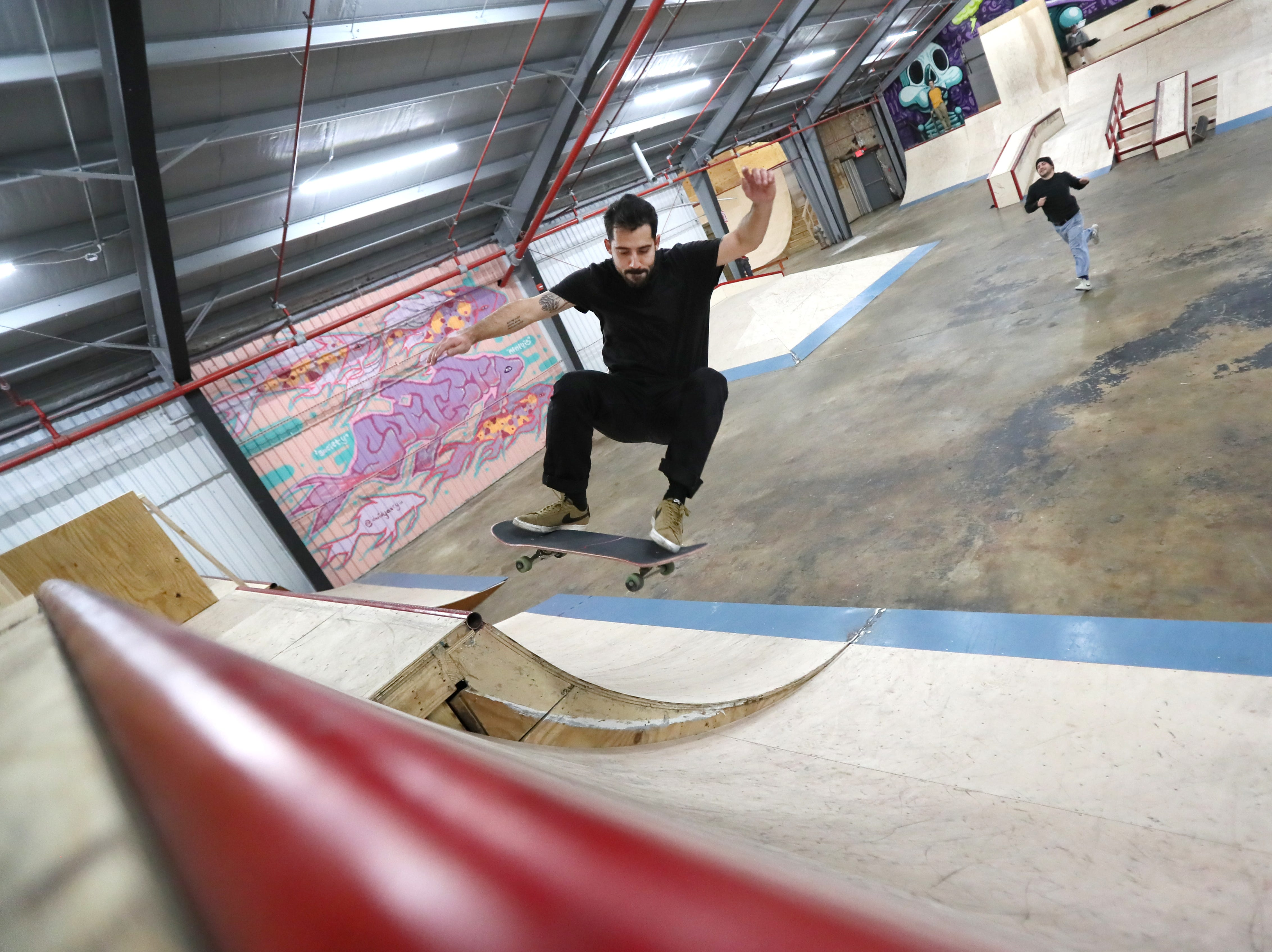 Richard Dalton, 29, rides inside Society Skatepark, a joint venture with Contact Skateboard Shop in the Broad Avenue Arts District which held its soft opening on Thursday, Dec. 20, 2018.