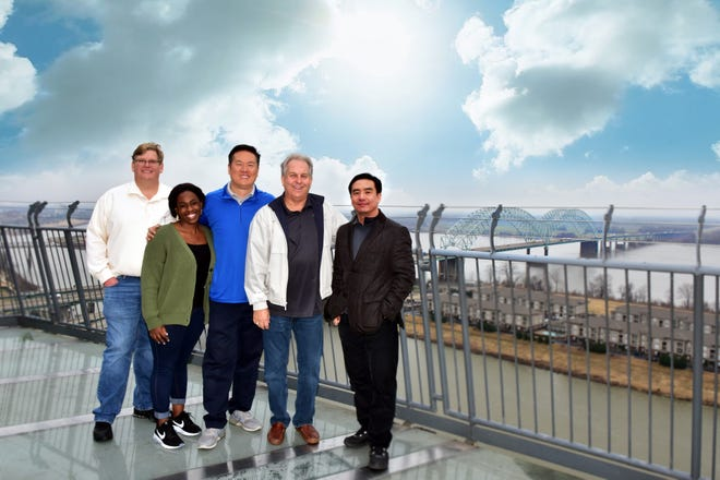 """From left, Mike McAnnally, Danielle Mitchell, Wei Chen, Bruce Pelynio and John Chen. All except McAnnally were killed in a plane crash on Dec. 20 in Georgia. McAnnally, who was not on the plane, issued a statement Wednesday remembering the """"brilliance"""" of his colleagues."""