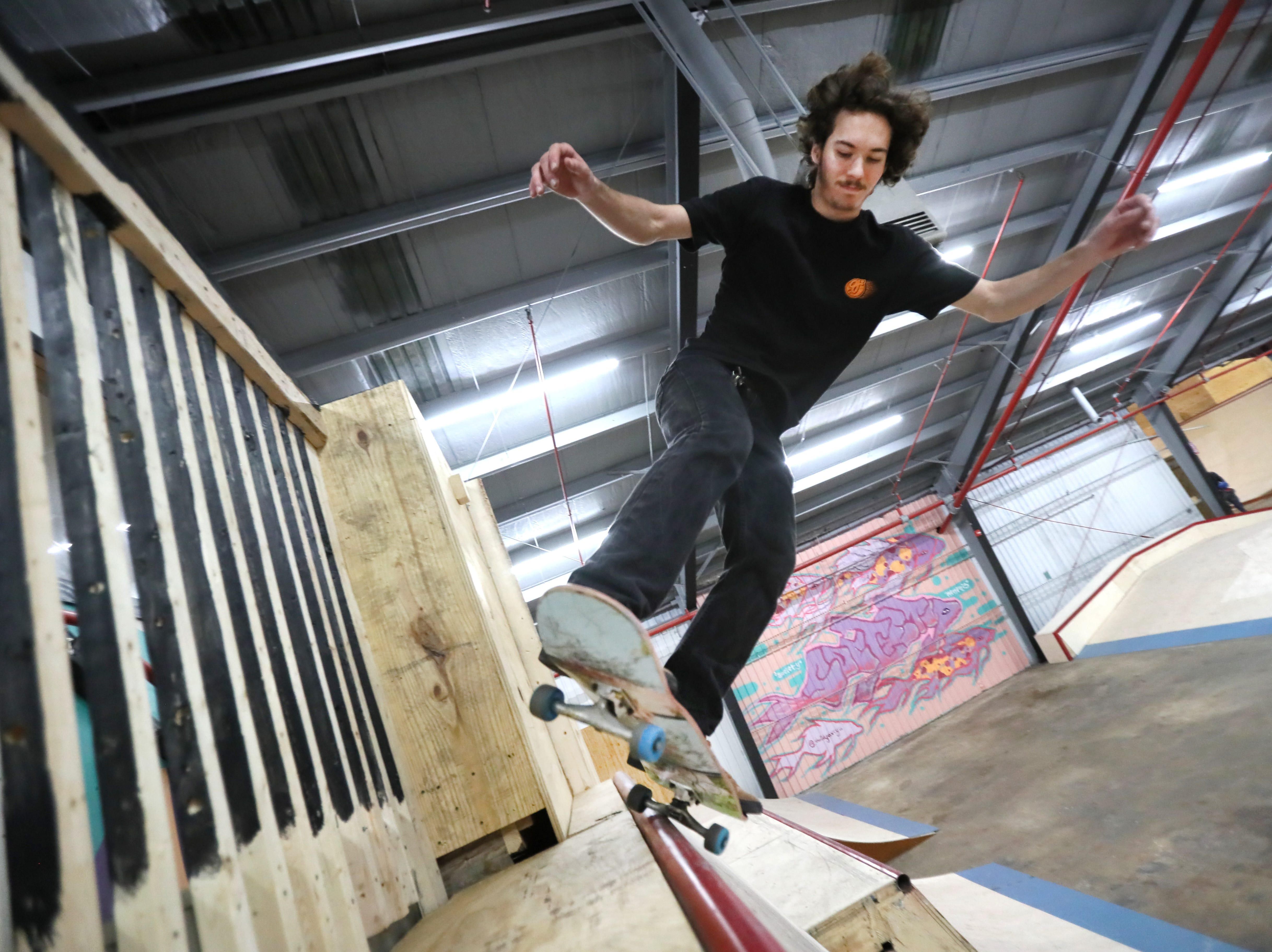 Jason weiner, 18, rides inside Society Skatepark, a joint venture with Contact Skateboard Shop in the Broad Avenue Arts District which held its soft opening on Thursday, Dec. 20, 2018.