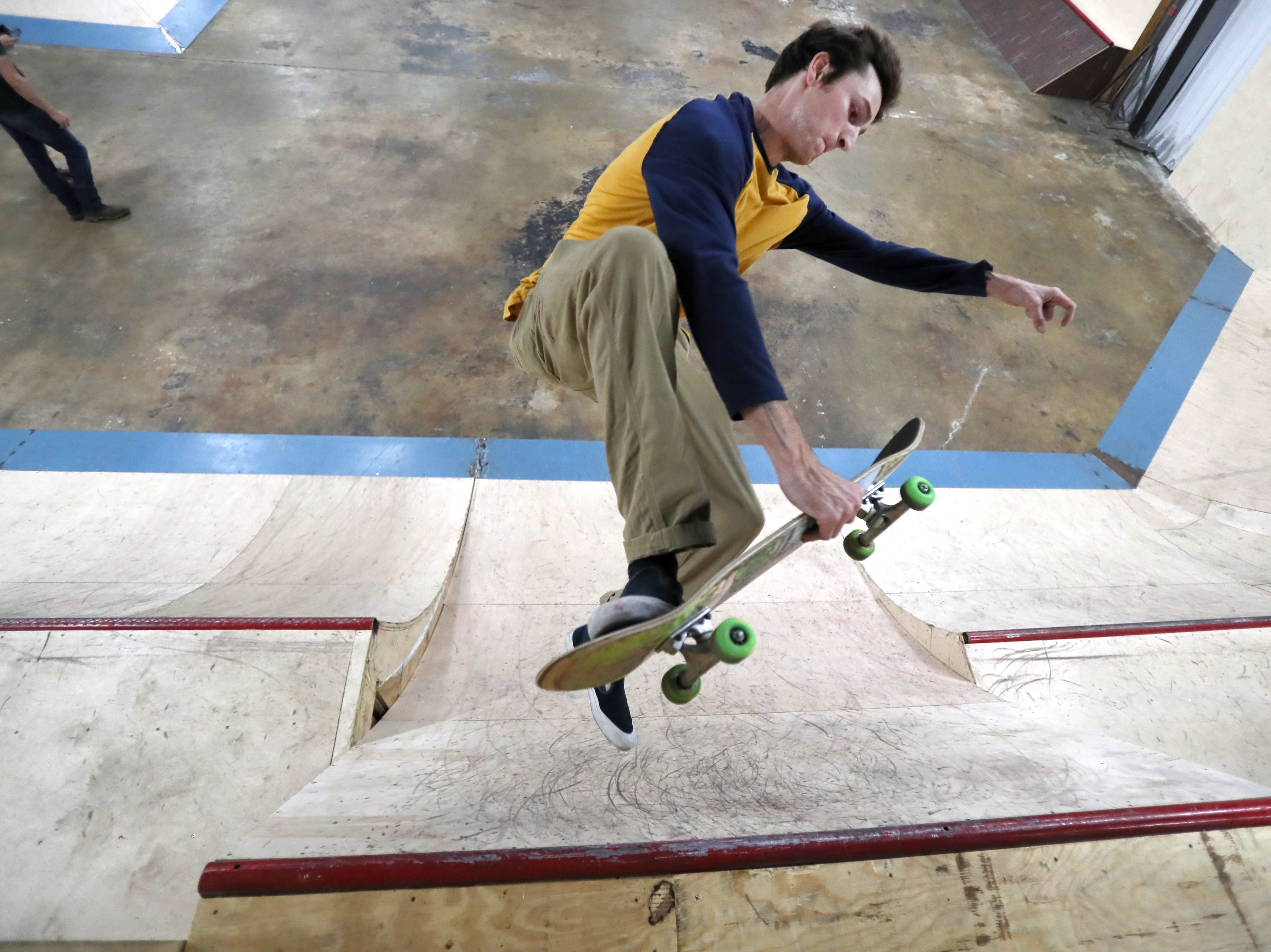 Crocker Rider, 25, rides inside Society Skatepark, a joint venture with Contact Skateboard Shop in the Broad Avenue Arts District which held its soft opening on Thursday, Dec. 20, 2018.