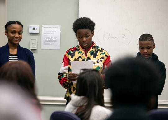 Javeon Bratcher, reads the names of the slaves sold at 87 Adams between 1854-1860 at the People's Movement in Memphis Theological Seminary, Thursday, Dec. 21, 2018.