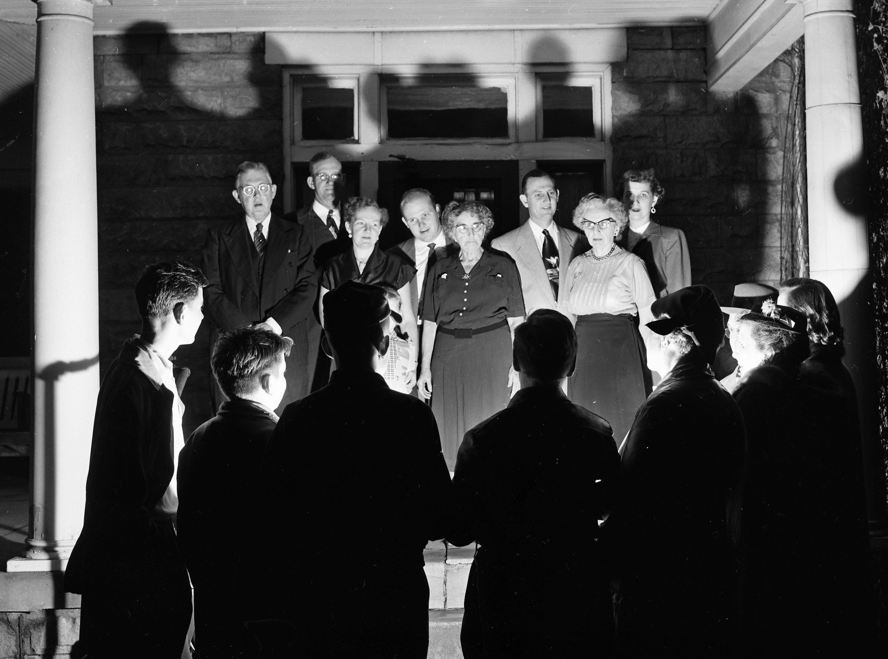 The sweet but gently sad strains of old beloved Christmas carols drew out a family party on 21 Dec 1953 at the home of Mrs. W. R. McDonald of 1399 Harbert — among thousands who heard carolers for the King's Daughters. Mrs. M.H. Speltz of Joy Circle led Boy Scouts from Troop 34 and others in canvassing Harbert for contributions to the Home for Incurables, following the carols.