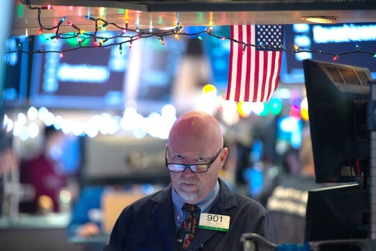A trader works on the floor of the New York Stock Exchange. Investors seem to think better times are ahead. Will history prove them right?
