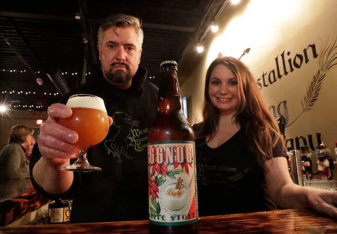 Erik and Kim Dorfner, owners of Westallion, show off their holiday production of Eggnog Beer, selling it by the glass and bottle. Beers such as this can be used for desserts.