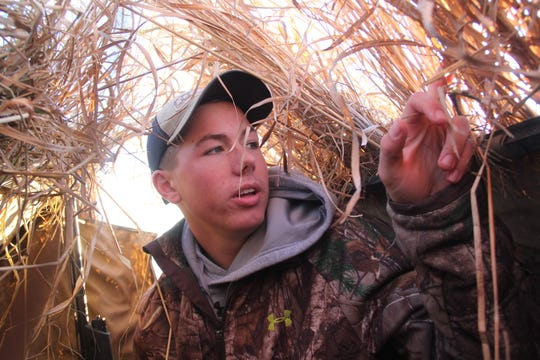 Evan Muche of Van Dyne, Wisconsin looks out from an A-frame blind during a Canada goose hunt west of Fond du Lac, Wisconsin.