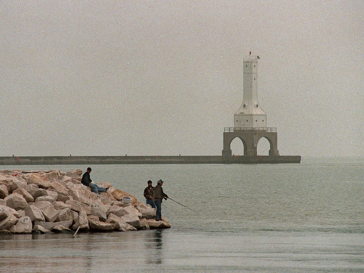 Anglers fish in Port Washington in March 1998.