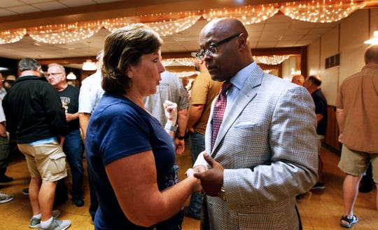 Sharon Bea (left) talks with Sheriff-elect Earnell Lucas before the start of the Milwaukee County Sheriff's Deputy retirees luncheon in Hales Corner