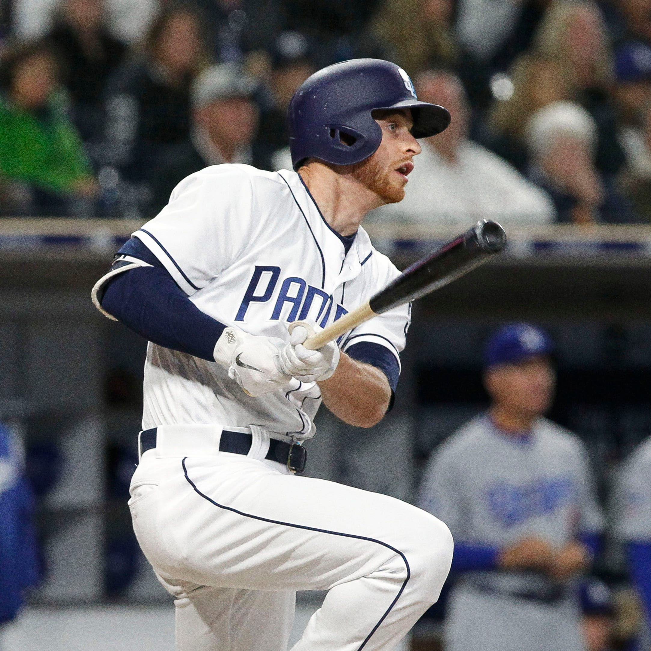 The San Diego Padres' Cory Spangenberg hits a...