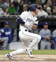 The San Diego Padres' Cory Spangenberg hits a single against the Los Angeles Dodgers at Petco Park in San Diego on April 18, 2018. The former first-round draft pick was released by the Padres on Friday, Nov. 23, 2018. (Hayne Palmour IV/San Diego Union-Tribune/TNS) ORG XMIT: 1247300