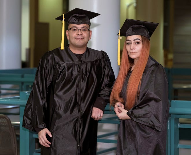 Michael Villarreal and his sister, Annamarie Villarreal, stand proud in their caps and gowns during graduation at Milwaukee Area Technical College's downtown campus Wednesday. Twenty years after dropping out of high school, they both completed MATC's high school equivalency diploma program at the West Allis campus, while at the same time working and raising children. The two have the same father but didn't find each other until 2011.