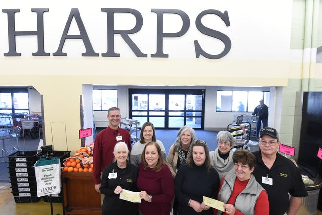 Harps grocery Store in Mountain Home recently gave $7,000 to local charities as part of the Harps Christmas for Communities program. In Mountain Home, the event benefited The Call, the Bob Davis Veterans Center, Serenity and Baxter House Adult Day care. The money comes from the 24th charity golf tournament held at Pinnacle Country Club in Rogers. Pictured are: (first row, from left) Harps employee Leota Bockstahler;Tena Recktenwald with Baxter House Adult Day Care; Shari Kane and Joanna Farris with the Bob Davis Veterans Center; (second row)Harps store leader Greg Harp;Sandy LaBahn with The Call;Donna Forrester with Serenity; andDawn and Virgil Miller,