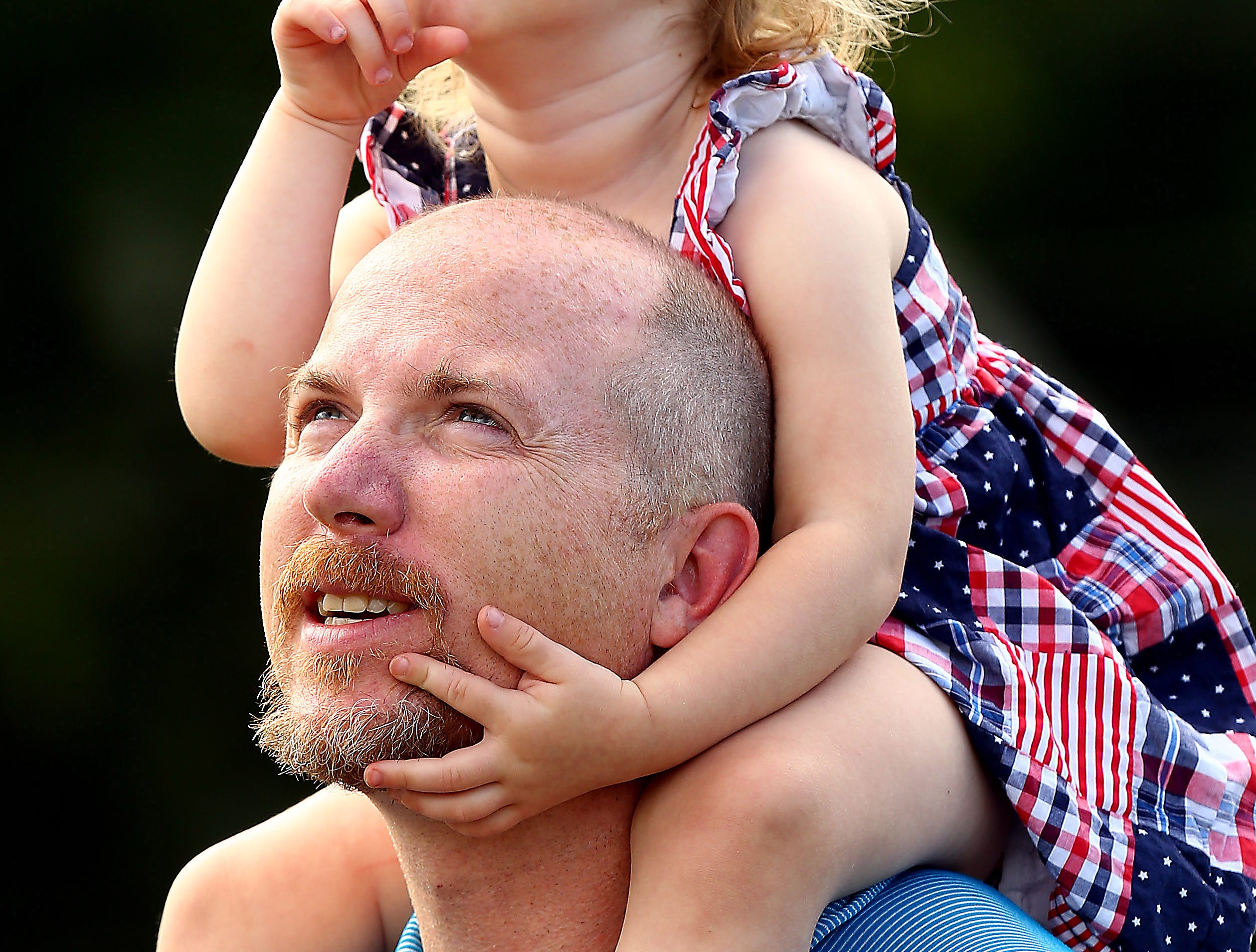 Michael Clear and daughter Meghan, 2, watch as 11-year-old Peter Clear, a fifth grade student from John Hill School in Boonton goes for a ride. Peter won the Quick Chek Balloon Festival's annual patriotic essay contest getting a chance for a tethered balloon ride at Boonton High School as the contest winner. June 20, 2018. Boonton, NJ