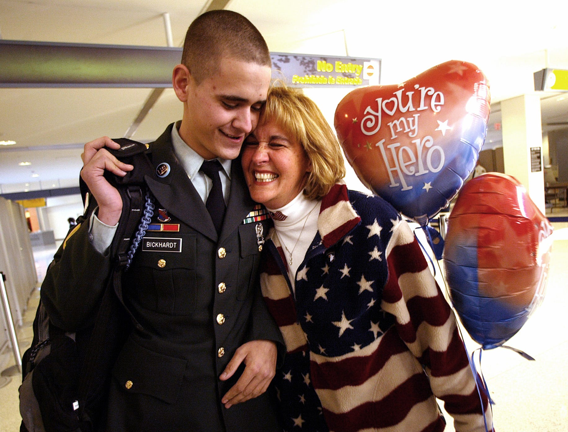 Newark--Nov. 27, 2003--PFC. Justin Bickhardt gets a huge hug from his Mom, Roberta Gaudioso as he  arrives at Newark Airport for approximately 24 hours of leave before heading back to Iraq.
