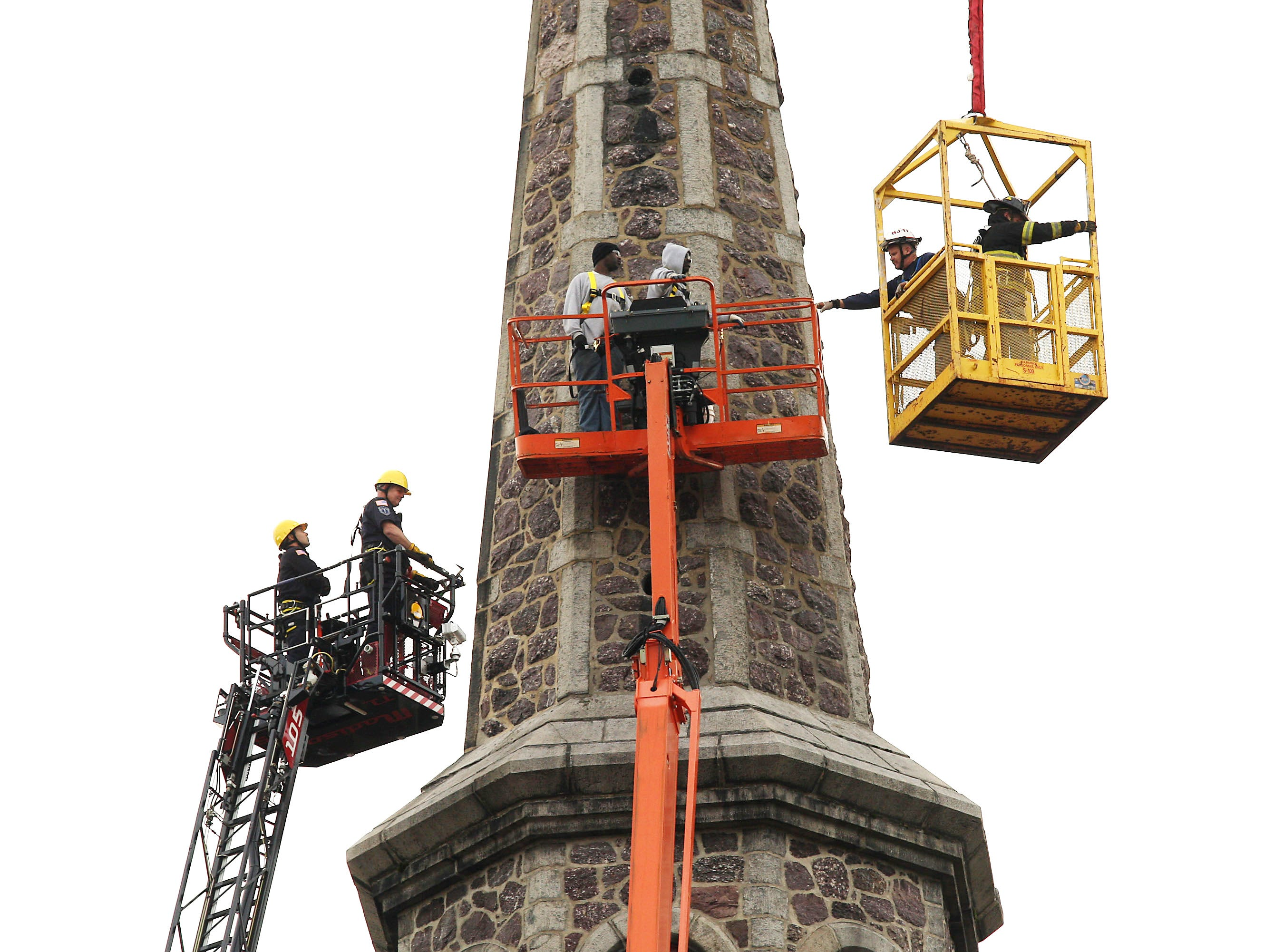 Morristown, 11/3/11-- Following a three-hour effort, two workers trapped on a lift 120 feet in the air against the steeple of the Morristown United Methodist Church were rescued. The men were performing restoration work on the church when the lift they were on became wedged against the steeple.
