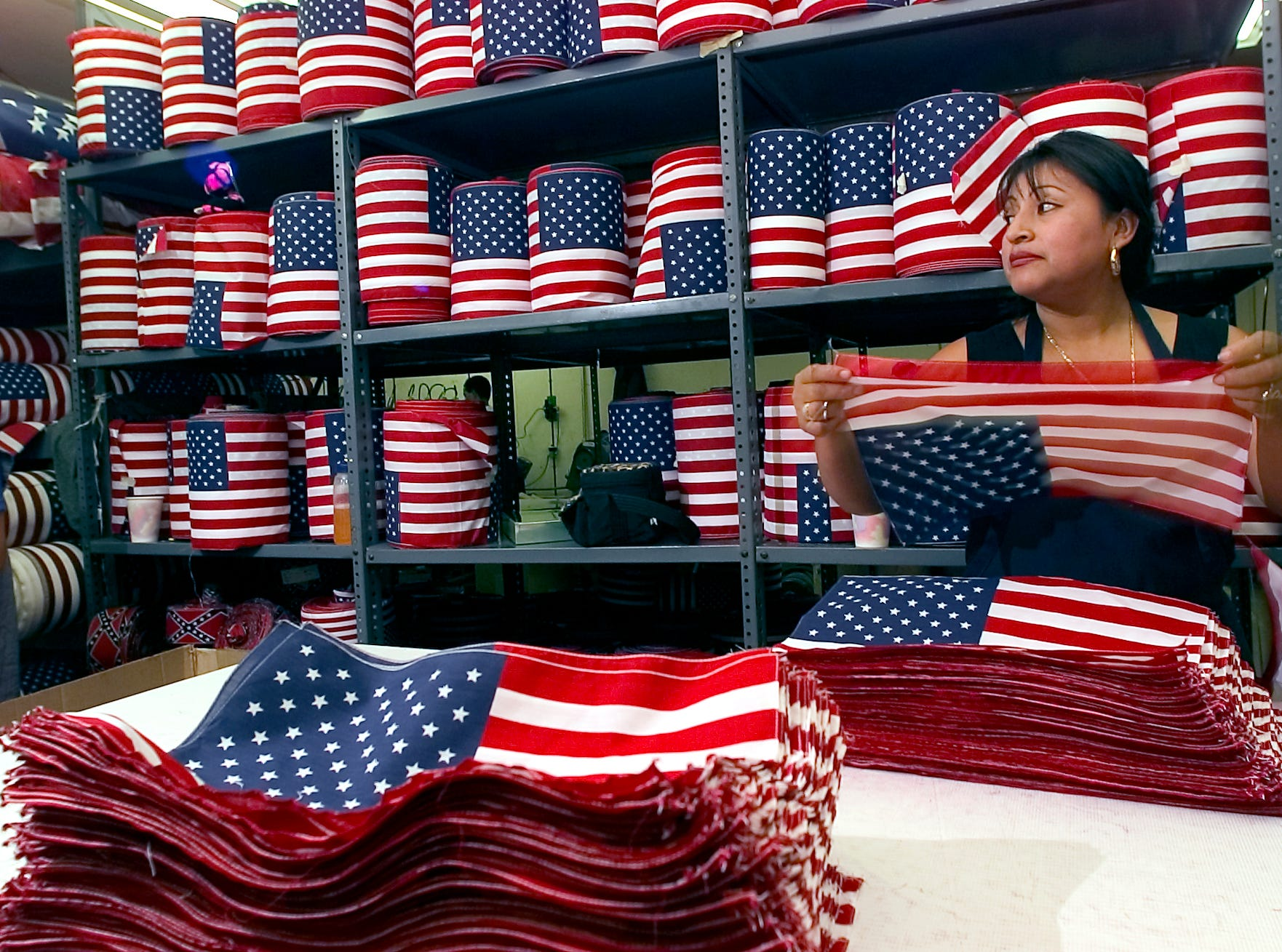 On September 12, 2001, a worker stacks American Flags at Metro Flag, one of the worldÕs largest manufacturers of hand-held U.S. flags in Dover, NJ was overwhelmed with high-volume orders from across the USA after the World Trade Center attacks.