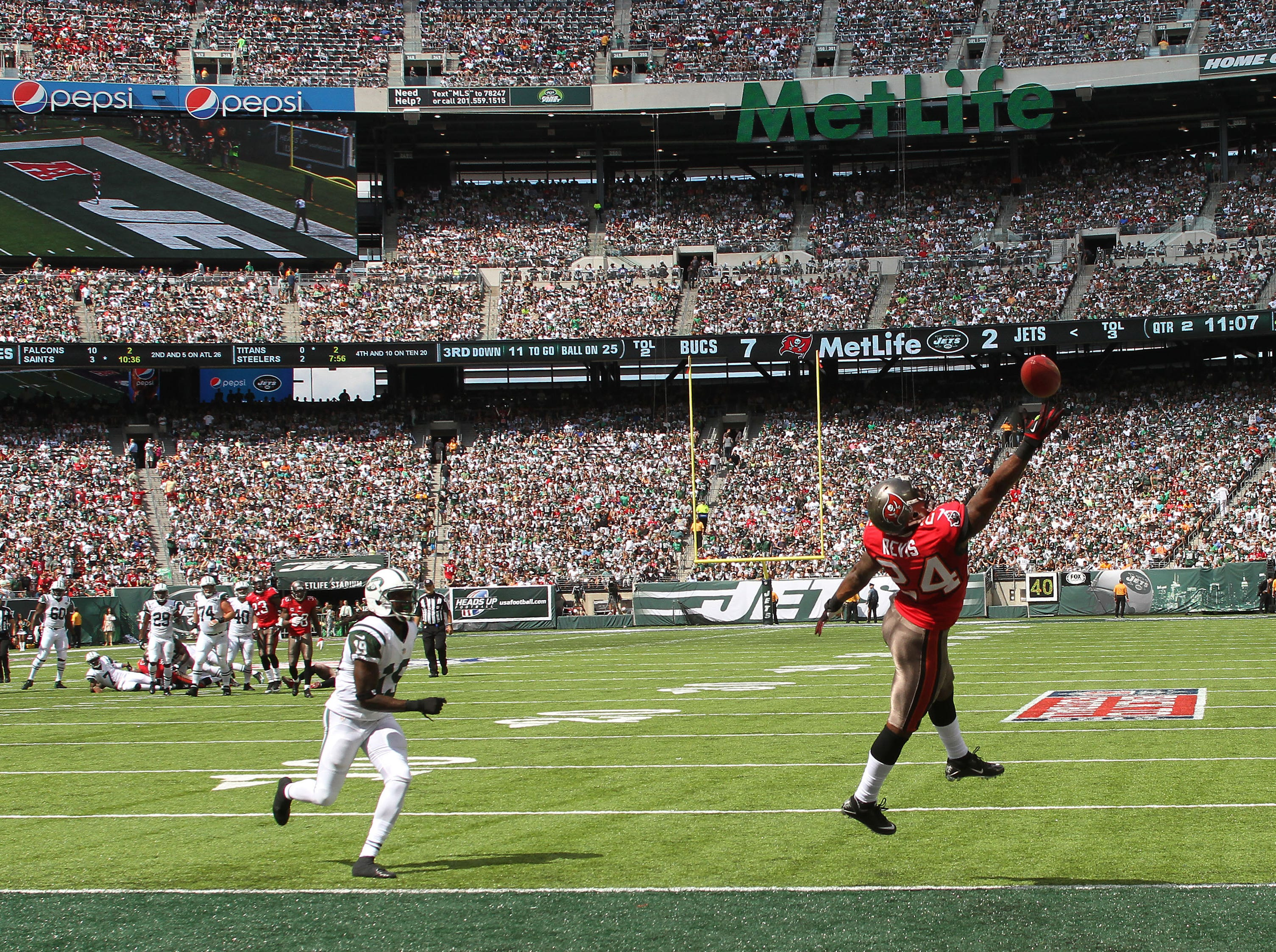 Tampa Bay cornerback Darrelle Revis reaches up to attempt an interception vs. the New York Jets at MetLife Stadium.
