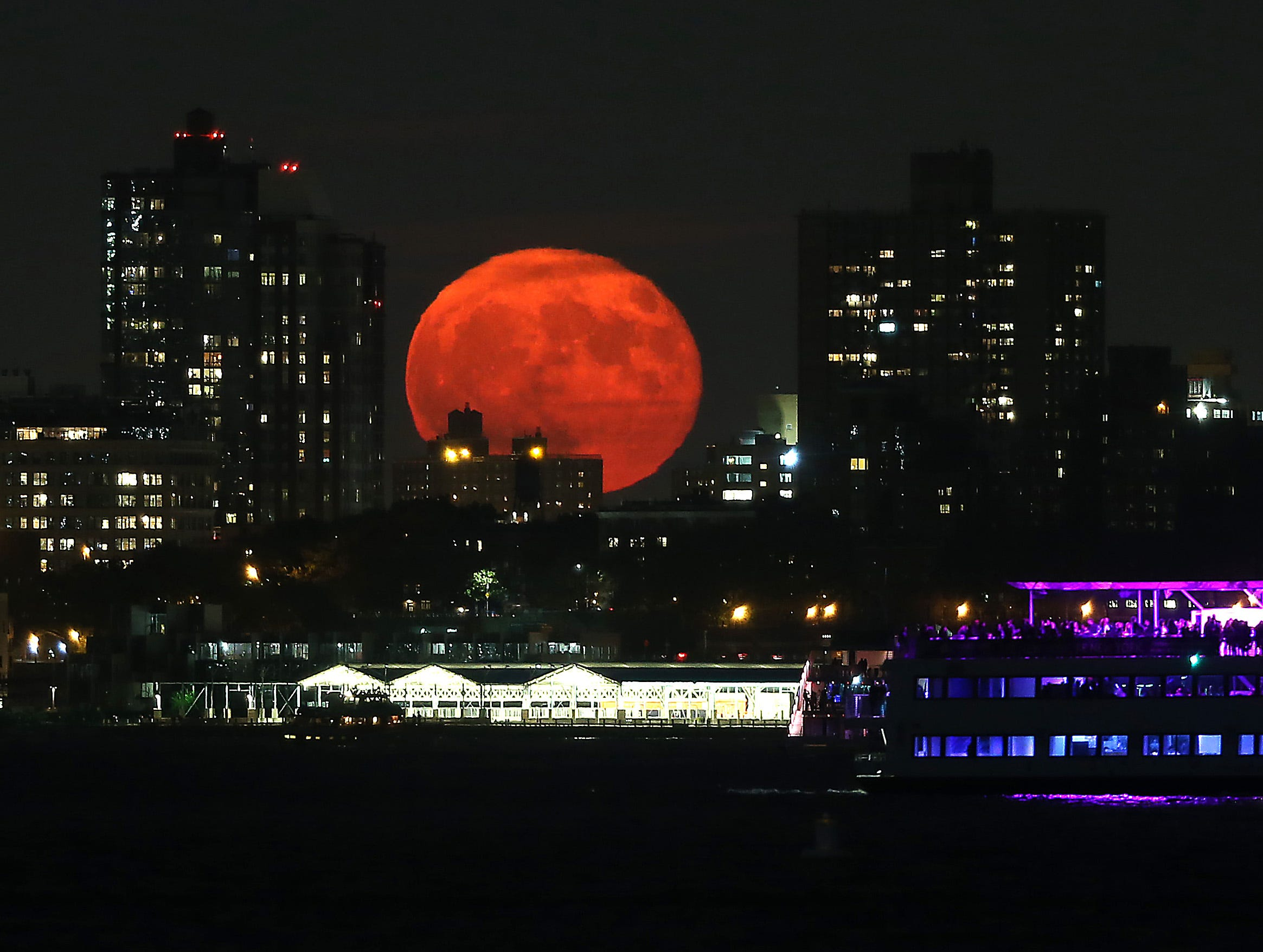Hunter's Super moon rises over Brooklyn as seen from Liberty State Park in Jersey City. Viewing was at its best on Sunday, when the moon is both full and at its closest point to our planet as it orbits Earth. October 16, 2016, Jersey City, NJ.