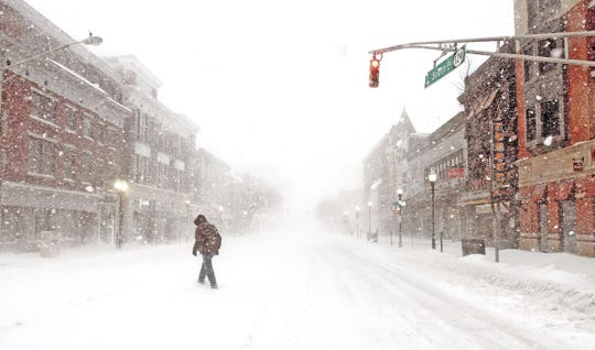 March 15, 2017--A man crosses South Street as a Nor'easter blasts N.J. and the Northeast with heavy snow, high winds. The late-winter storm dropped almost three feet of snow in parts of Morris County.