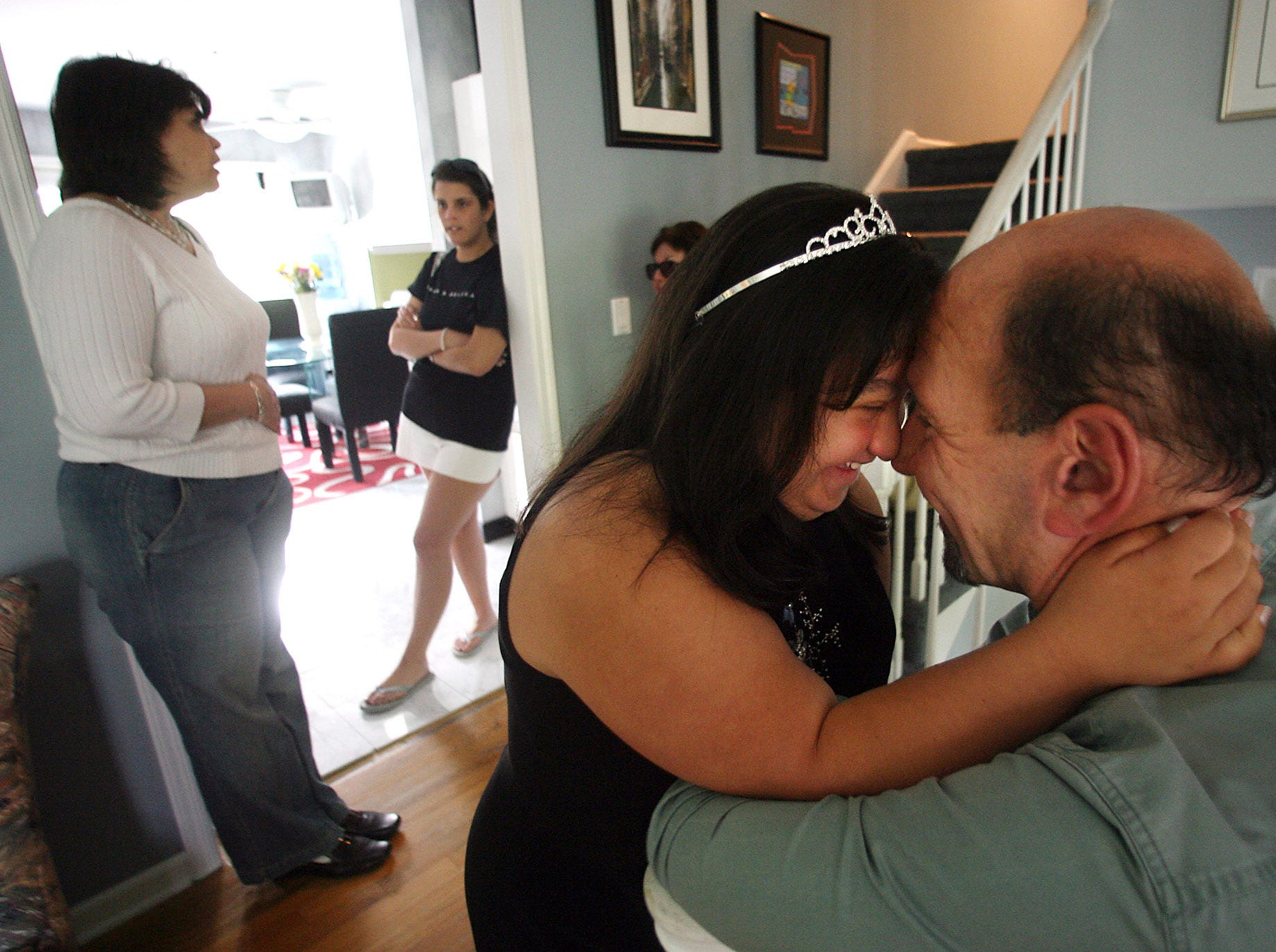 Alicia Vitiello shares a moment with her dad, Tom, telling him she loves him while she waits for the arrival of her date for the  junior prom. May 12, 2006, East Hanover, NJ
