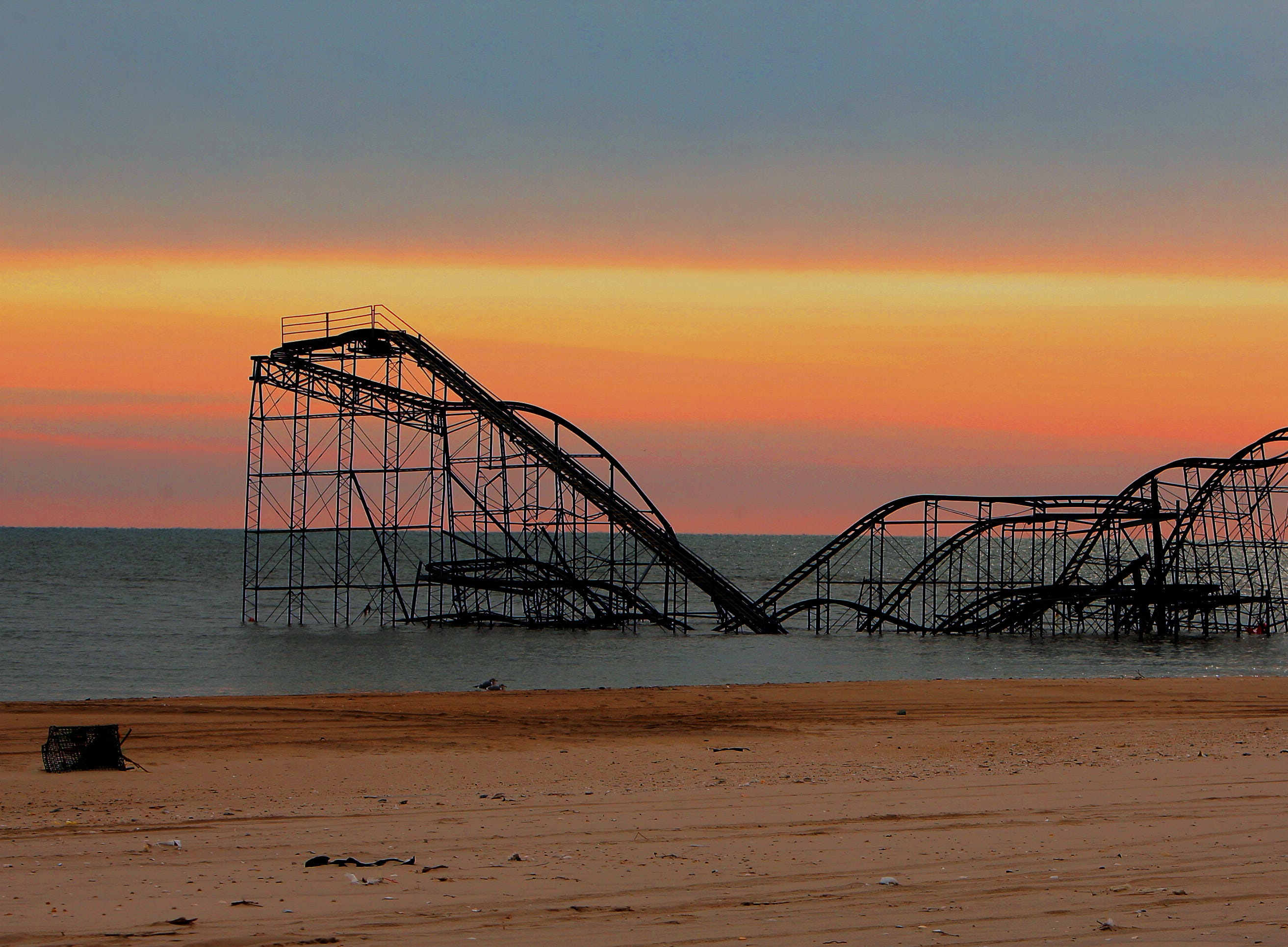 The sun rises behind the Jet Star, perhaps the most iconic symbol of Superstorm Sandy's devastation at the Jersey shore, the roller coaster plunged off an amusement pier in Seaside Heights during the October storm. December 31, 2012. Seaside Heights, N.J.