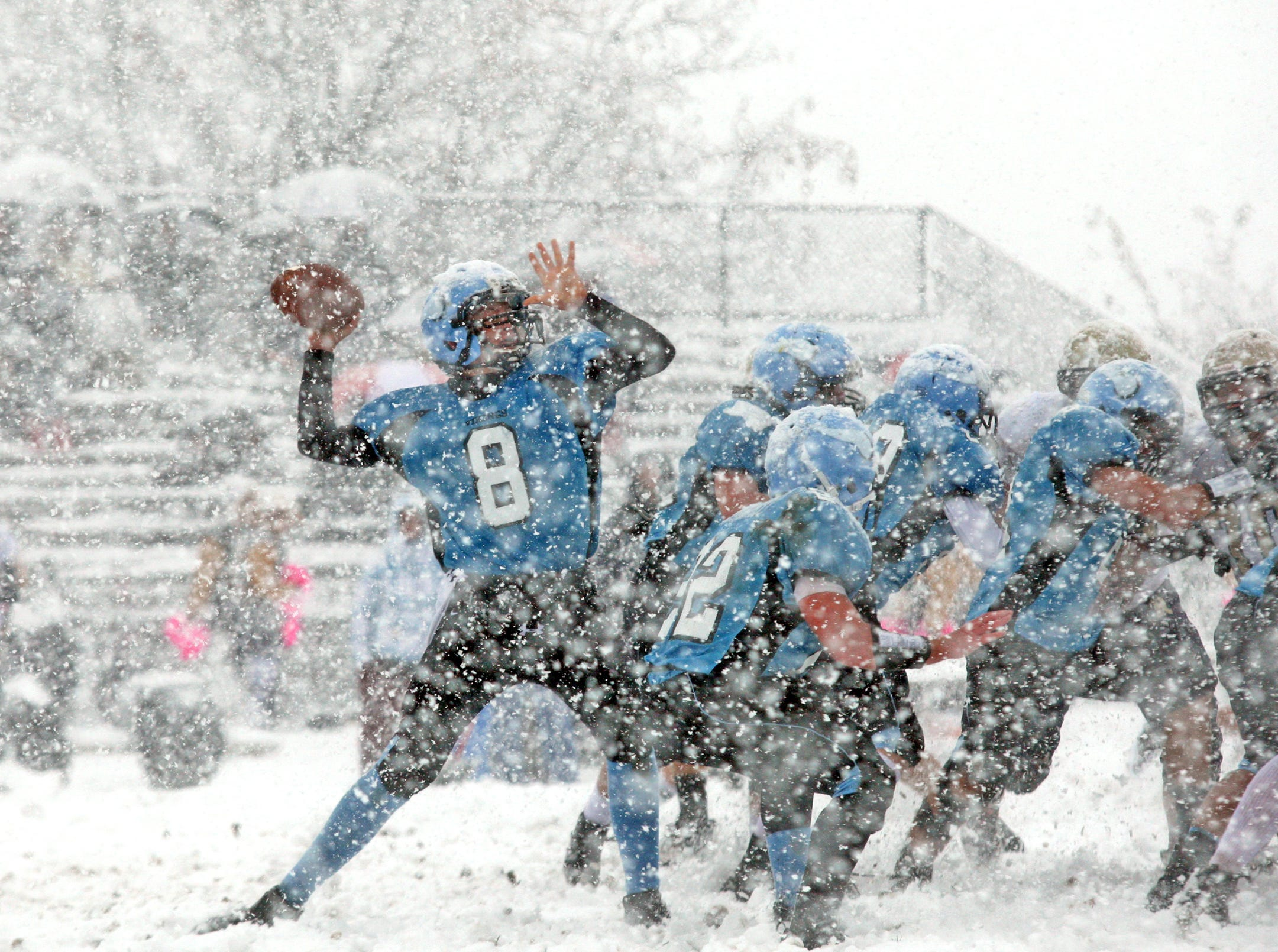 Parsippany, 10/29/11--Parsippany Hills quarterback Tyler Simms passes vs Roxbury High School on football Saturday, when a freak nor'easter dumped as much as 19 inches of snow on parts of New Jersey, the most ever for the month of October since record keeping for the state began in 1895. 
