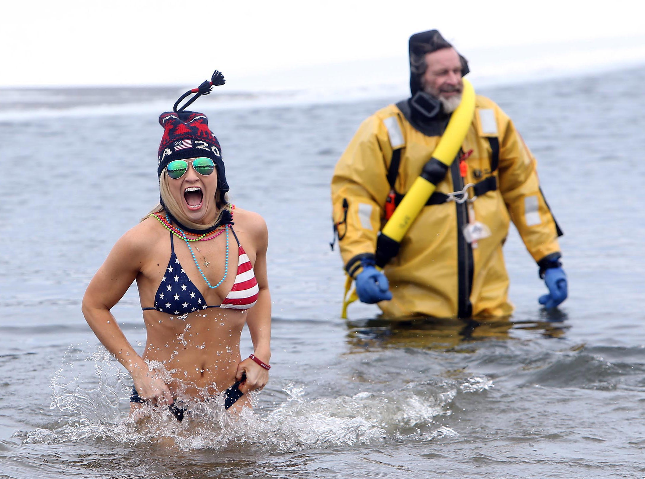 February 12, 2017--Amanda Glass of Metuchen, NJ lets out a yell as mild weather brought out hundreds to the 8th Annual Leap in the Lake sponsored by the Lake Hopatcong Elks #782 for Our Special Kids at Hopatcong State Park.