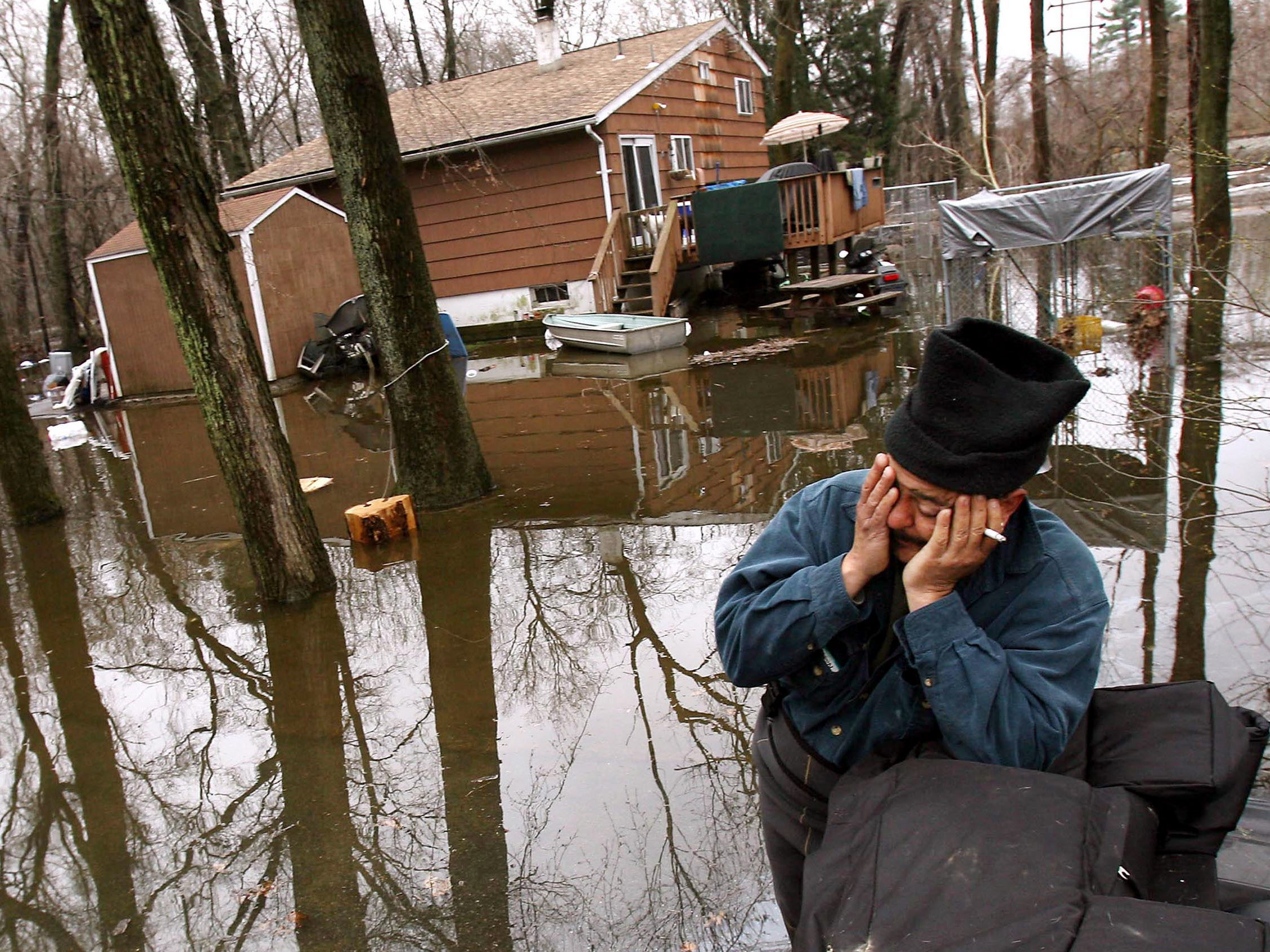 Harrison Road resident Jerry VanDunk shows his frustration after the second time in two weeks, they found themselves underwater after up to two inches of rain fell over the area again flooding the area around the Pequannock River. March 23, 2010 Pompton Plains, NJ