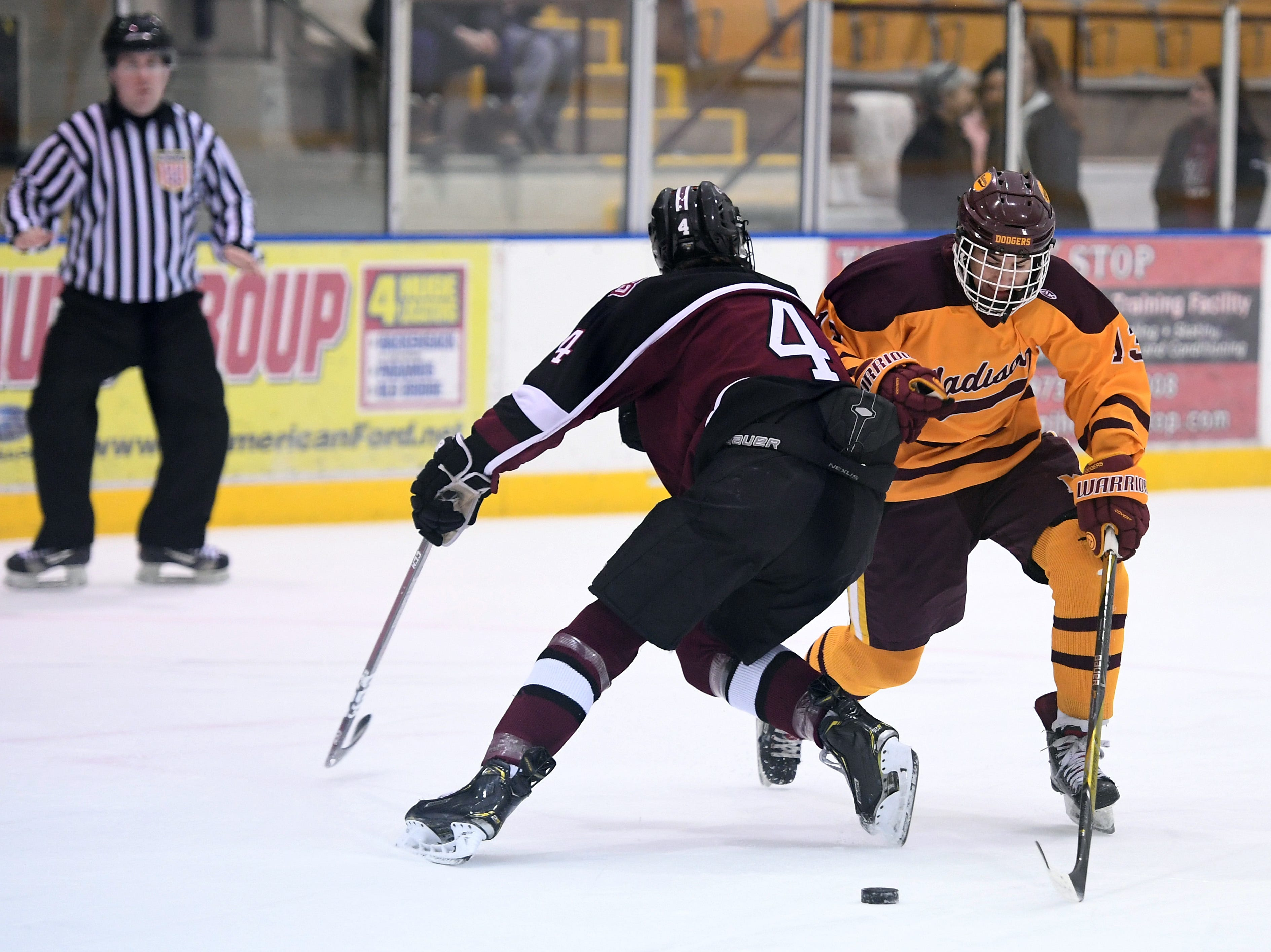 Madison ice hockey vs. Morristown-Beard at Mennen Sports Arena on Thursday, December 20, 2018. Madison #13 Dave Renzulli works to get past Morristown-Beard #4 Billy Moloney.