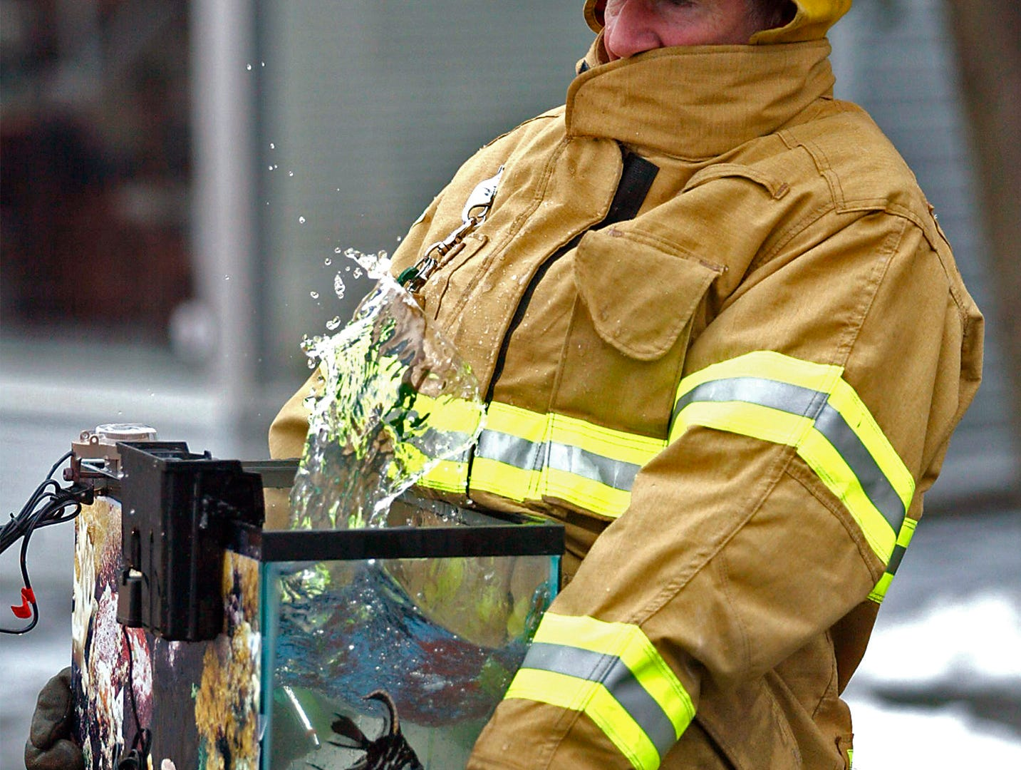 January 8, 2003, Morristown firefighter Fred Richardson rescues an angel fish from a Morristown house that was next to a burning abandoned lumber yard.