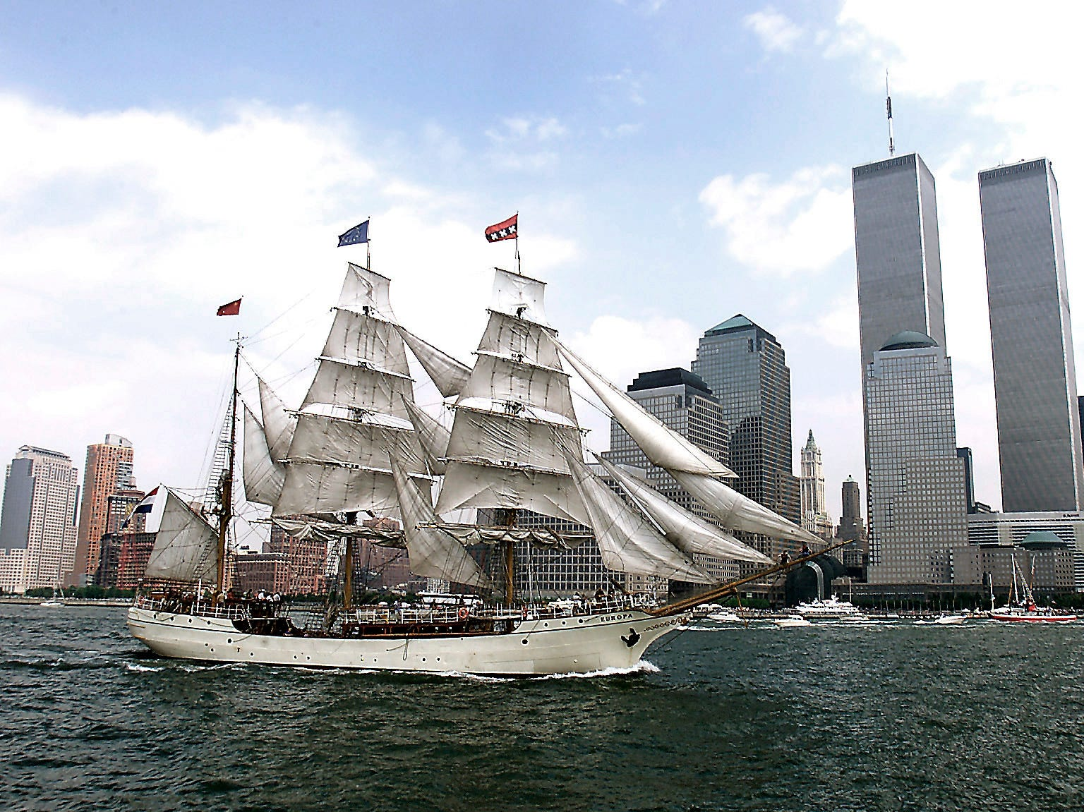 July 4, 2000--The boat Europa sails past the World Trade Centers Twin Towers on the Fourth of July during OP Sail, 2000.