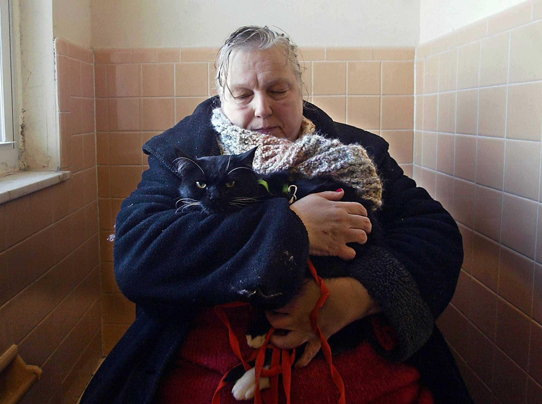 For a series called Living on the Brink, a series written by Lorraine Ash about the effects of poverty on one of the wealthiest places in the United States, Morris County New Jersey. Lorraine and I spend six months on the project, much of it on our own time. Here, Janet Miller tries to calm her cat sitting in the bathroom of her freezing unheated Parsippany apartment minutes before she was to be evicted. February 1, 2005, Parsippany, NJ