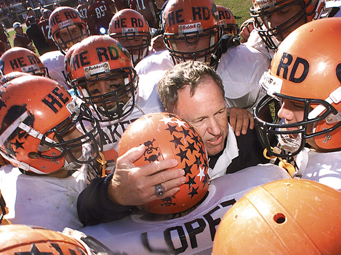 Whippany, Oct 28, 2000--Mountain Lakes head football coach Doug Wilkins hugs his players after his Morris County record 237th win.