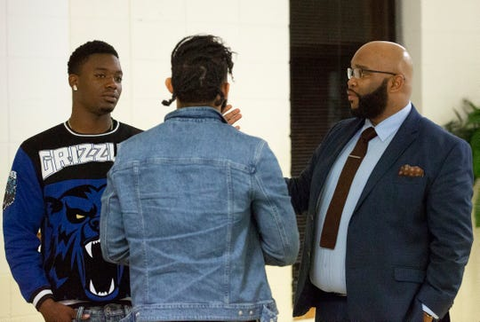 Tim Anderson, director at the Helping Montgomery Families Initiative, talks with two young men after a Bible study class at his church, Southside Church of Christ.