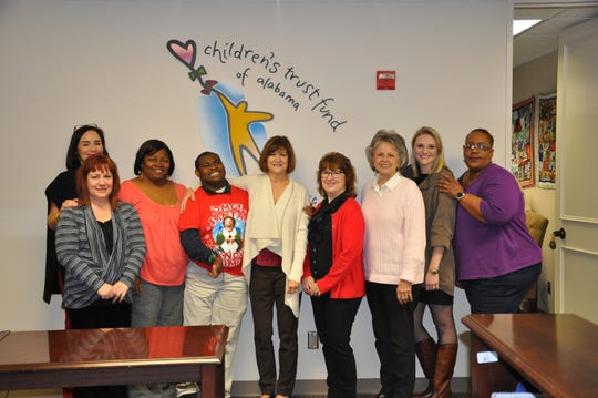 Staff from the Alabama Department of Child Abuse & Neglect Prevention met with Joseph Bradley and his mother, Mary Bradley, to present them with a donation toward his trip to the Special Olympics World Games.