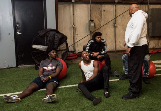 Todd Dowell talks to local high school football players who come to hang out even on their holiday break at the MadHouse gym in Montgomery, Ala., on Thursday, Dec. 20, 2018.
