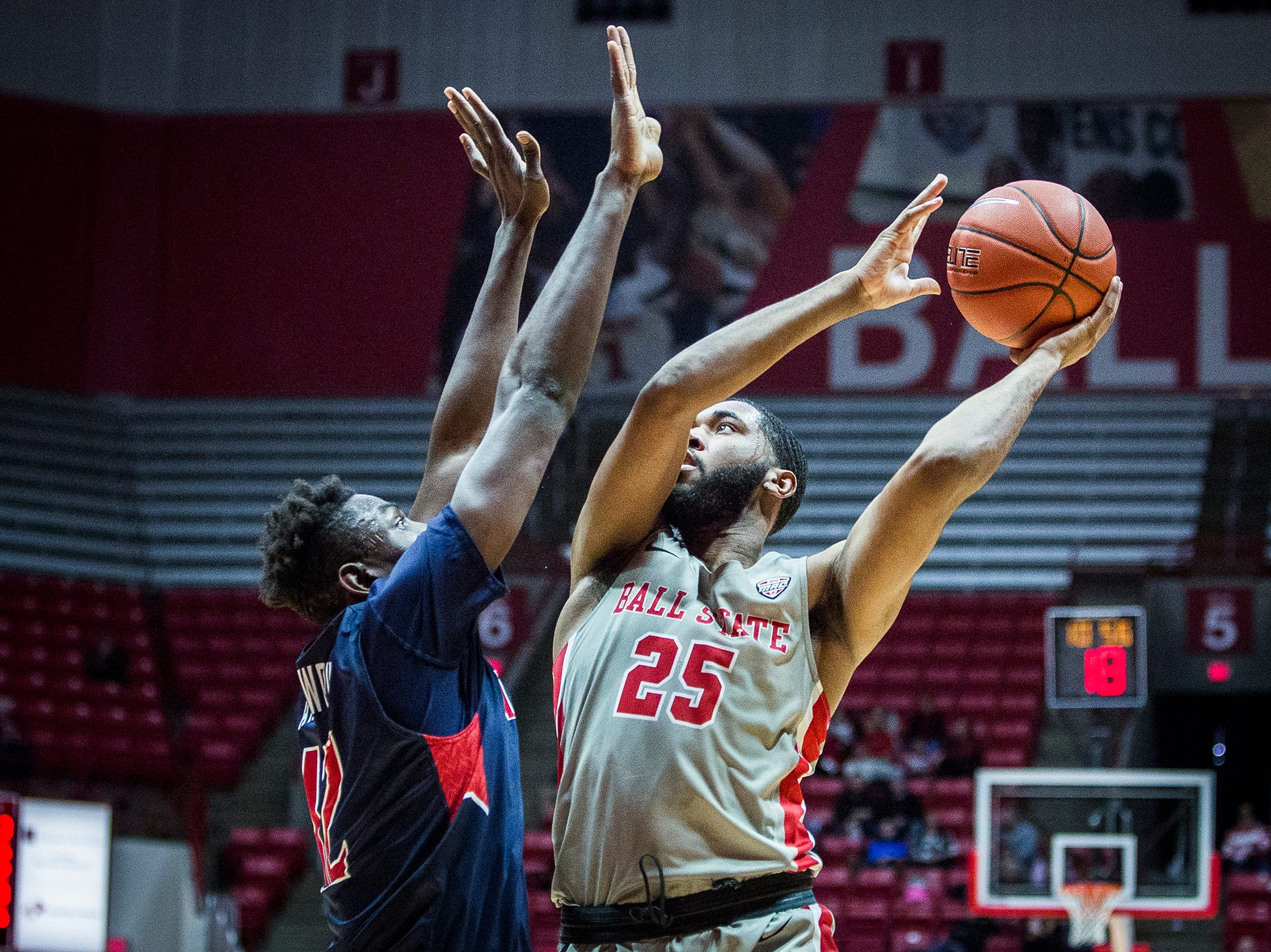 Ball State's Tahjai Teague shoots past Howard's defense during their game at Worthen Arena Thursday, Dec. 20, 2018.