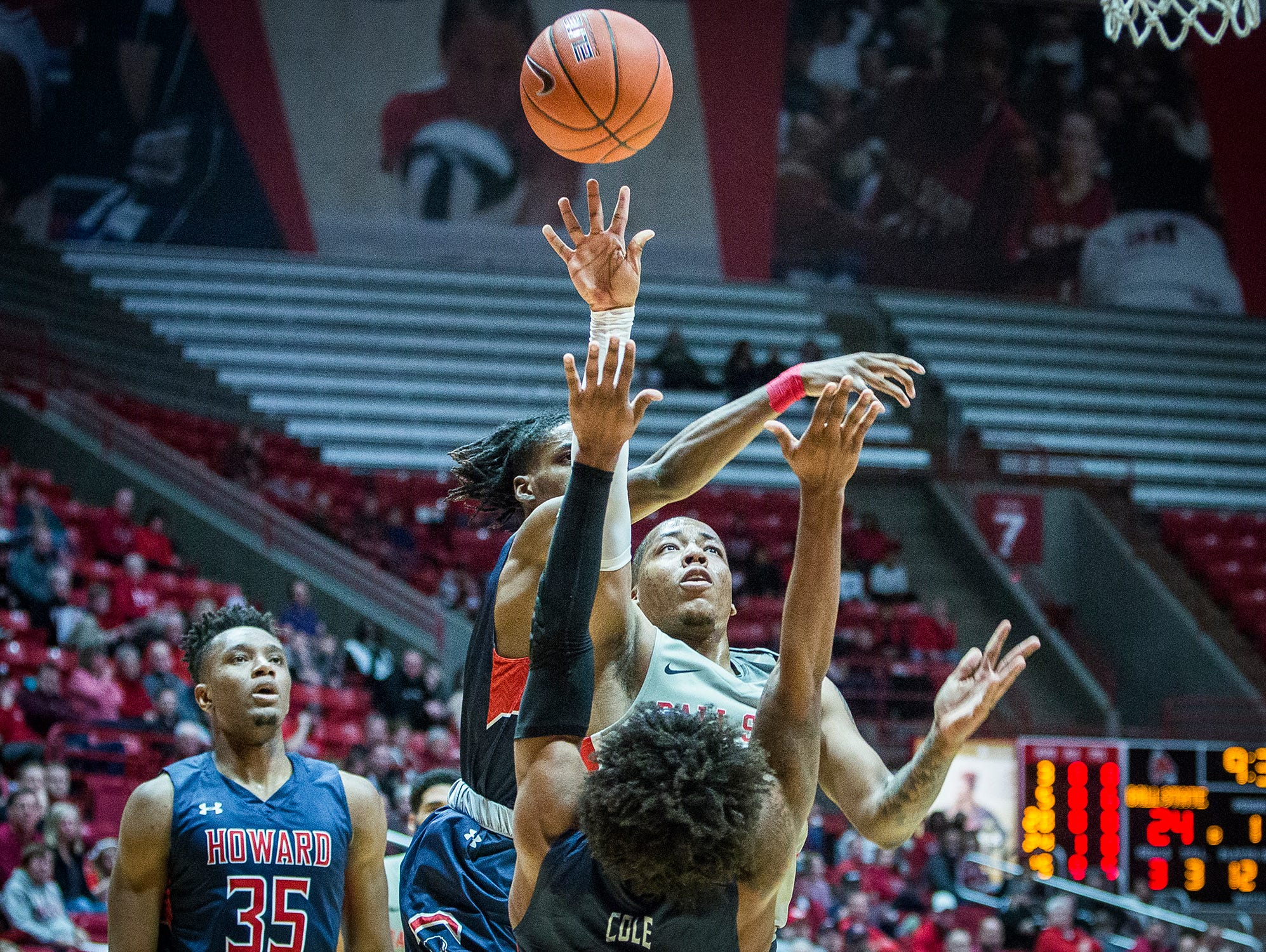 Ball State's Ishmael El-Amin shoots past Howard's defense during their game at Worthen Arena Thursday, Dec. 20, 2018.